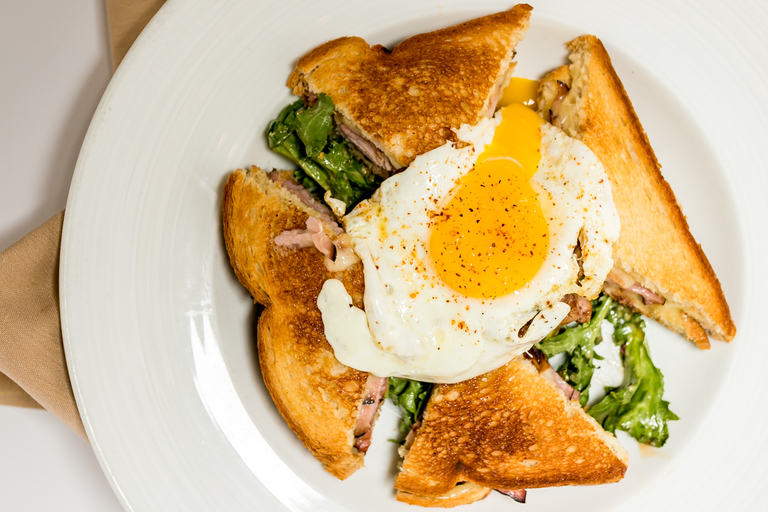 Croque Monsieur (ham and cheese): chicken confit, sauteed chicken liver, frisee salad, vinaigrette, topped with a fried egg / Image:{ } Amy Elisabeth Spasoff // Published: 7.12.18