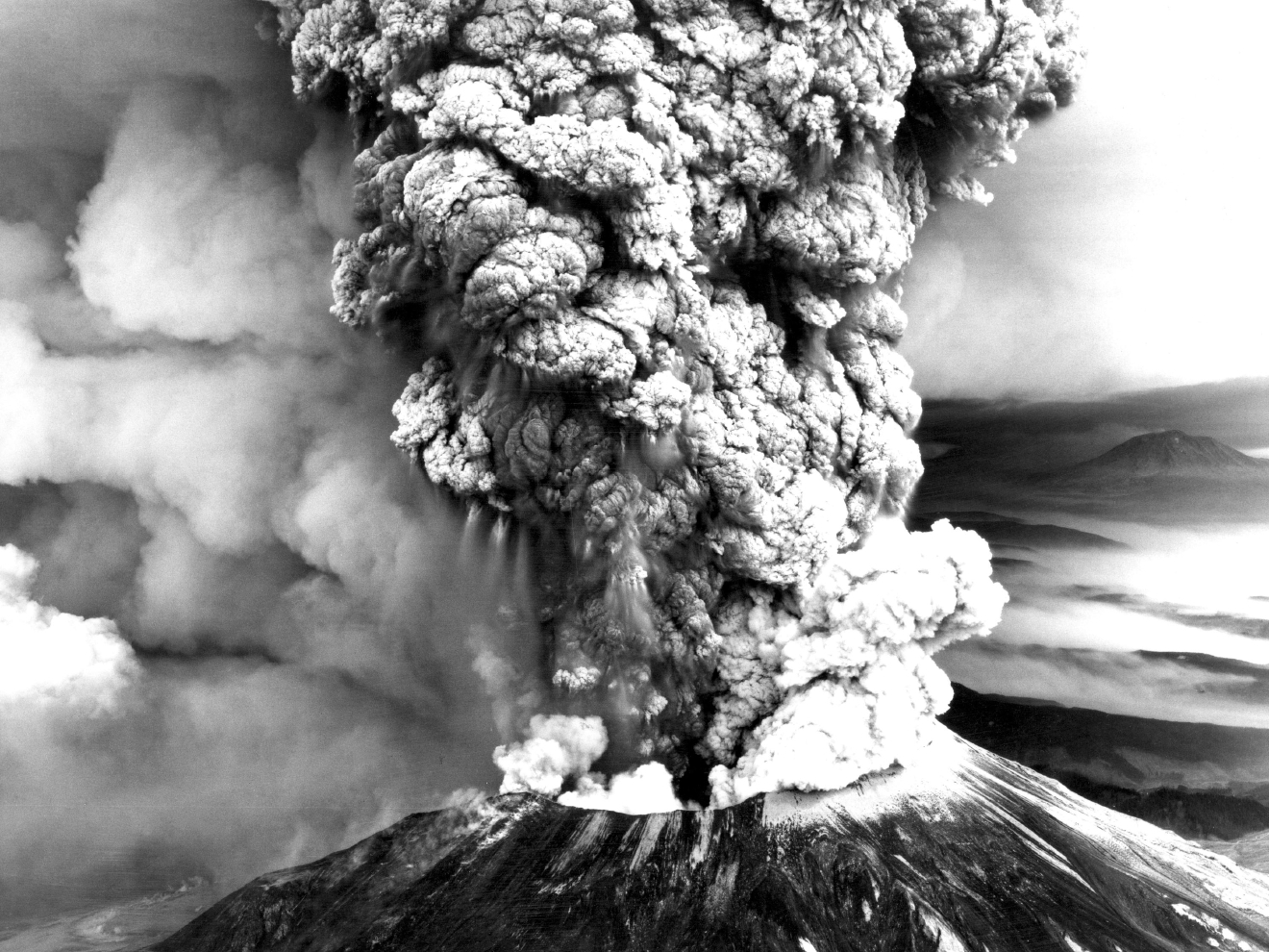 Mount St. Helens stood silent for over a century. Earthquakes swarmed the mountain in March 1980. Cracks appeared in the snow and ice atop the peak a few days later. And on March 27, the ash spewed from the top of the volcano.Geologists worked to study the peak as it rumbled back to life.What happened next caught the scientific community off guard.At 8:32 a.m. on May 18, 1980, a 5.1 earthquake shook the mountain.The mountain didn't erupt up; it erupted out to the side.The mountain went from 9,677 to 8,364 feet tall in an instant.All told, 57 people died or disappeared. (Robert Krimmell/USGS)