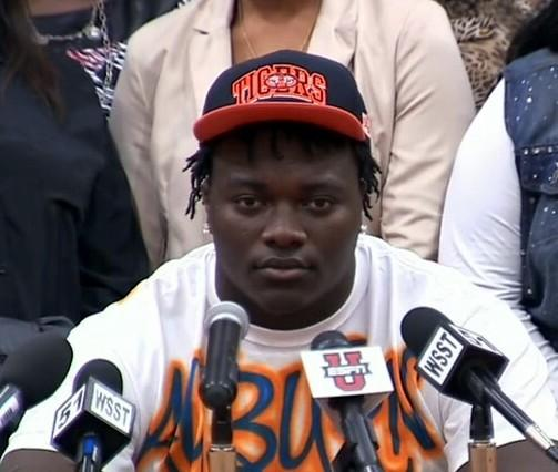Five-star defensive tackle Montravius Adams of Vienna, Ga. signs his letter of intent to play football at Auburn University on National Signing Day, Wednesday, February 6, 2013.