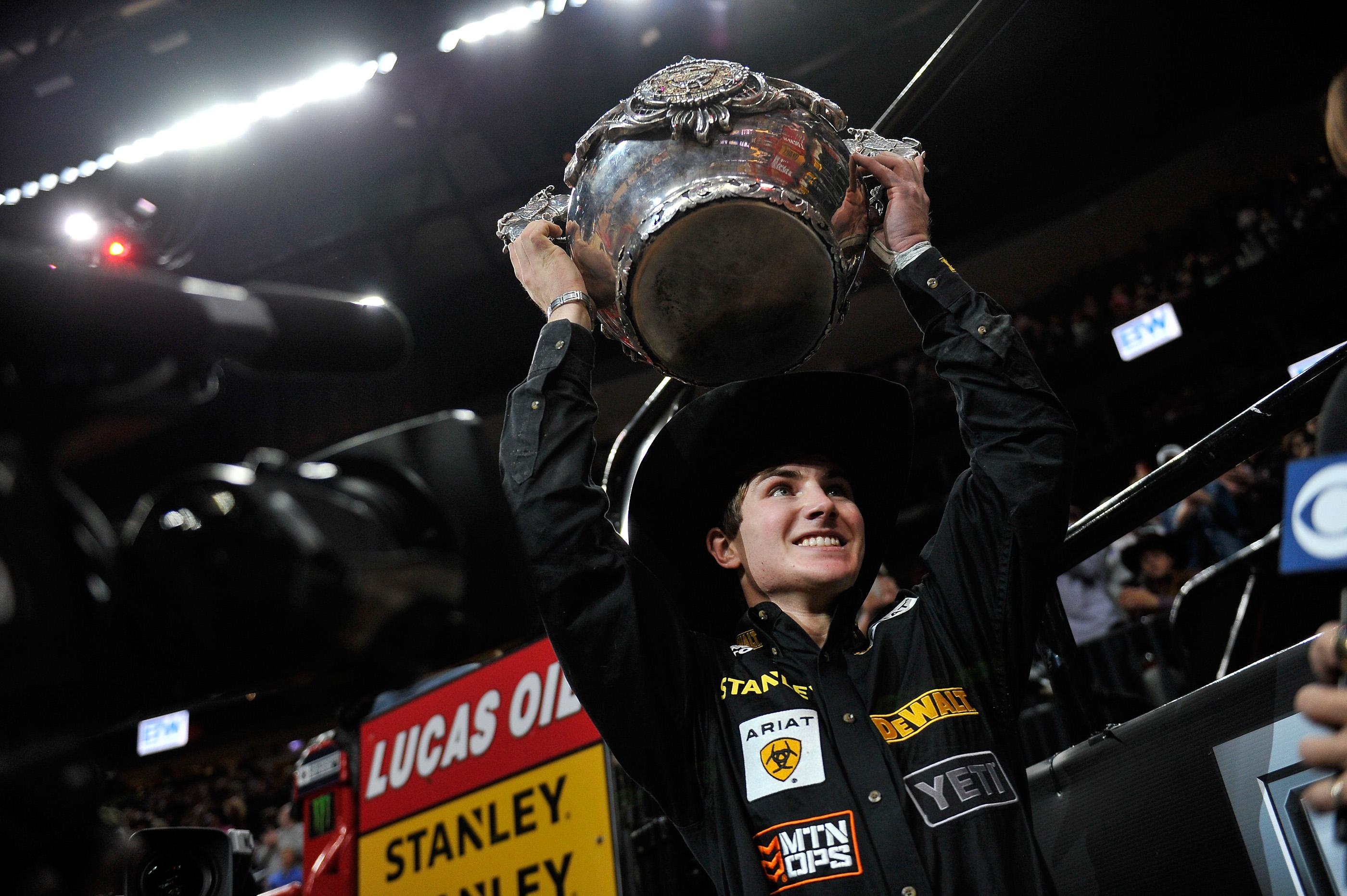 Jess Lockwood smiles with a trophy after being named the 2017 PBR World Champion at the PBR World Finals at T-Mobile Arena Sunday, Nov. 5, 2017, in Las Vegas. [David Becker/Las Vegas News Bureau]