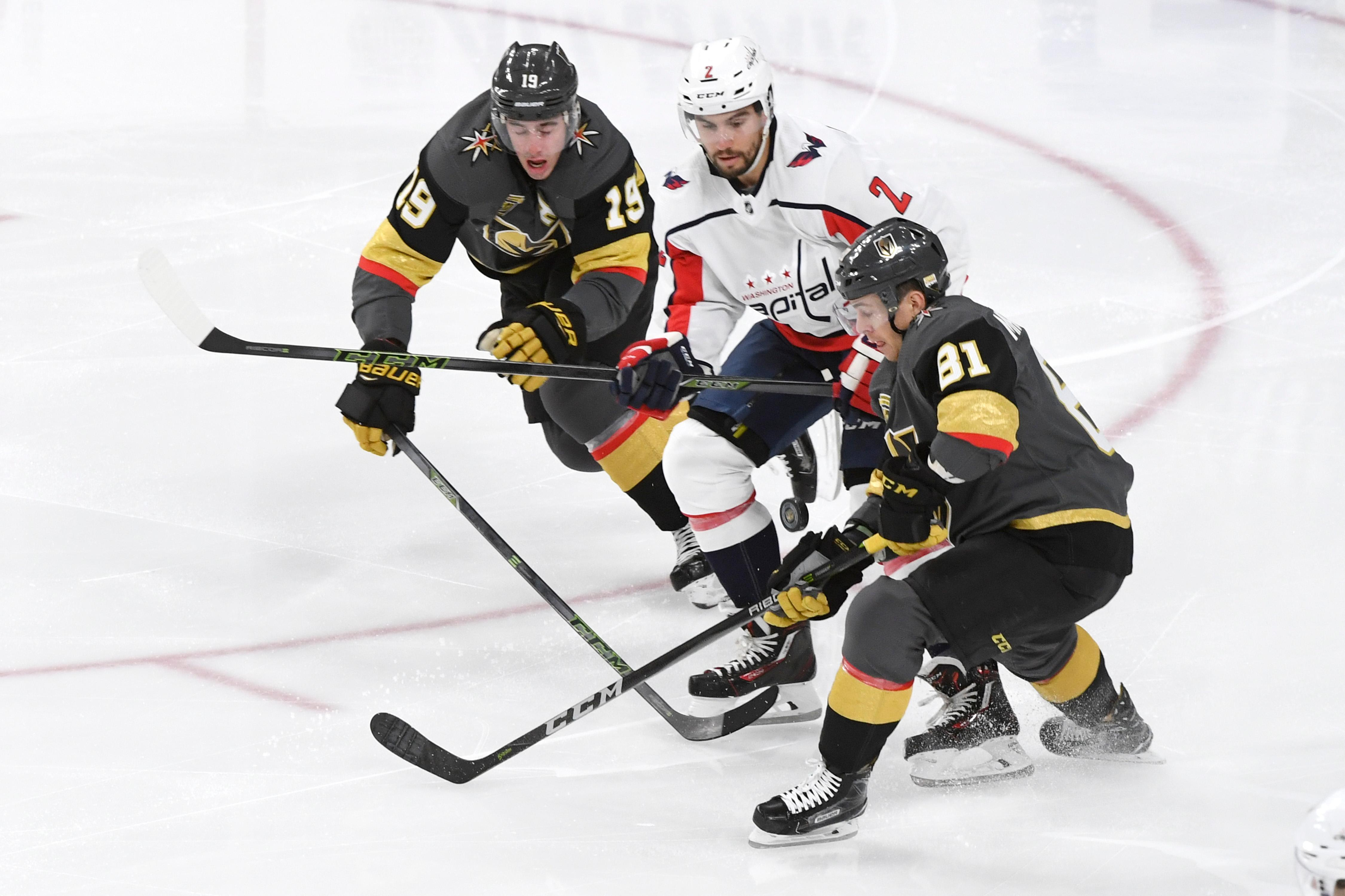 Vegas Golden Knights right wing Reilly Smith (19) and Vegas Golden Knights center Jonathan Marchessault (81) are challenged for the puck by Washington Capitals defenseman Matt Niskanen (2) during their NHL hockey game Saturday, December 23, 2017, at T-Mobile Arena in Las Vegas.  CREDIT: Sam Morris/Las Vegas News Bureau