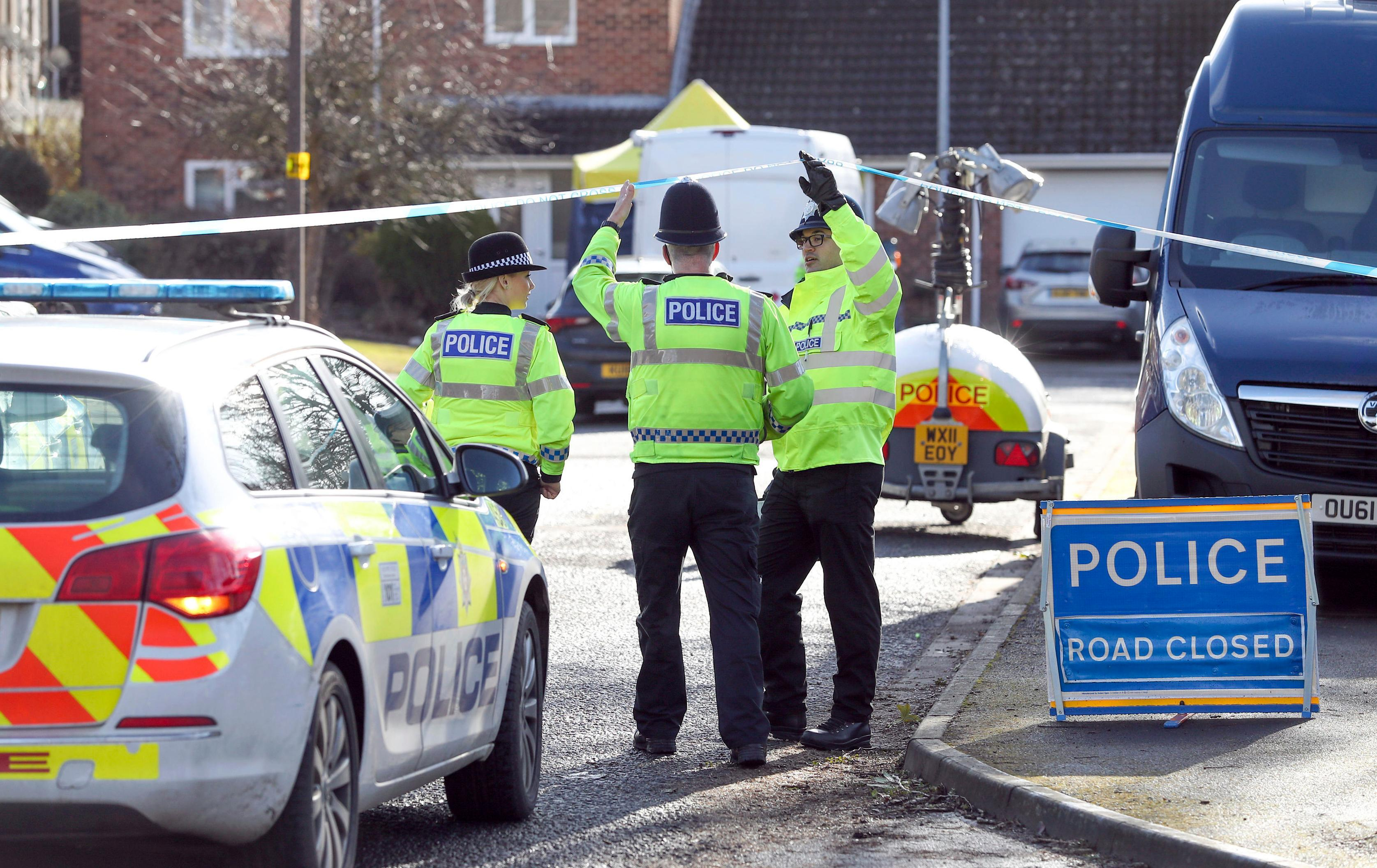 Police officers seal off a cul-de-sac in Salisbury, England, near to the home of former Russian ex-spy Sergei Skripal as a nerve agent is believed to have been used to critically injure him and his daughter Yulia. Britain's Home Secretary says the investigation into the nerve agent attack on a Russian ex-spy and his daughter is focusing on three sites — his home, a pub and a restaurant. (Andrew Matthews/PA via AP)