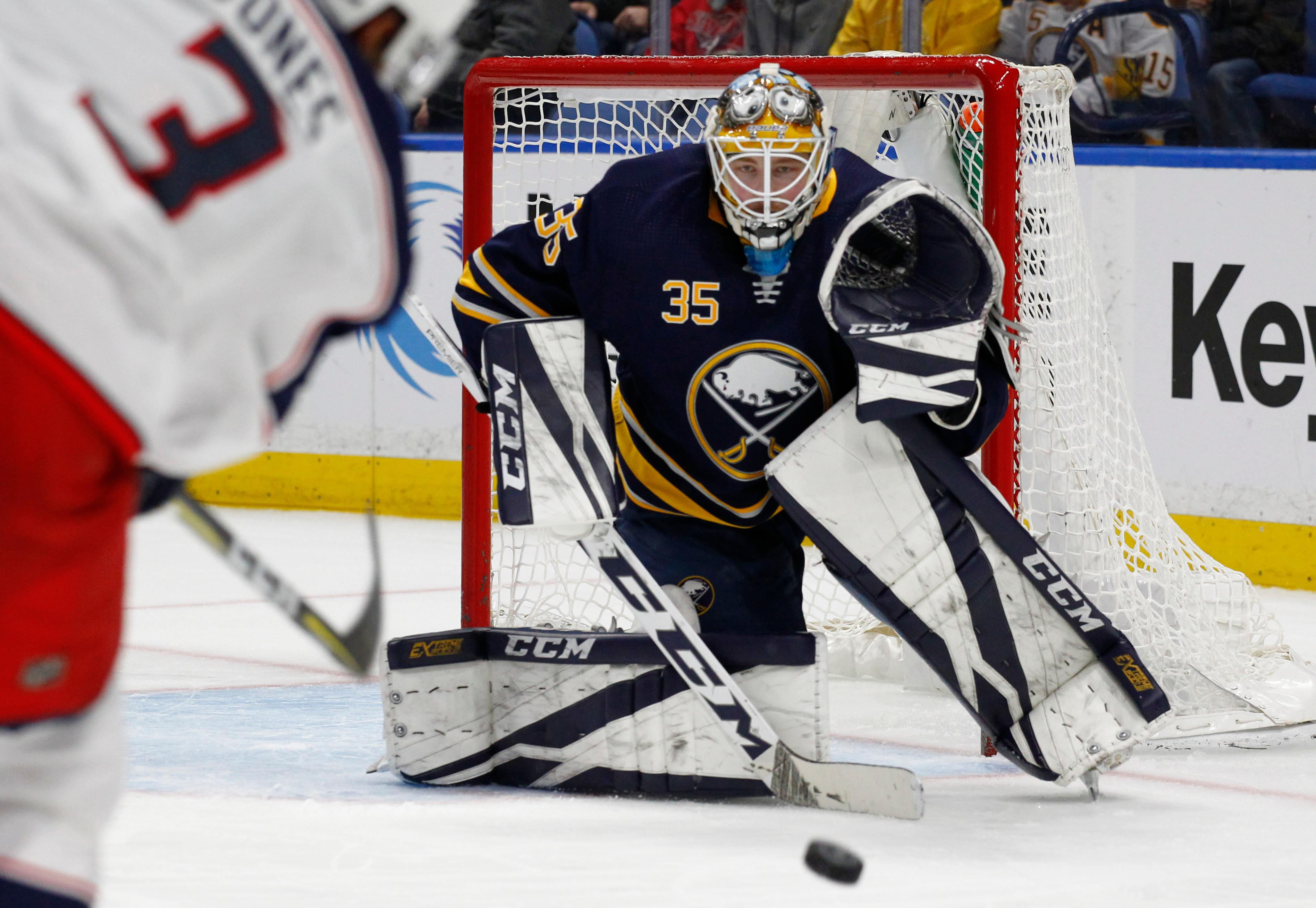 Buffalo Sabres goalie Linus Ullmark (35) watches the puck after a shot by the Columbus Blue Jackets during the second period of an NHL hockey game Thursday, Jan. 11, 2018, in Buffalo, N.Y. (AP Photo/Jeffrey T. Barnes)
