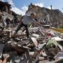 Rescuers pull victims from rubble in Italy quake