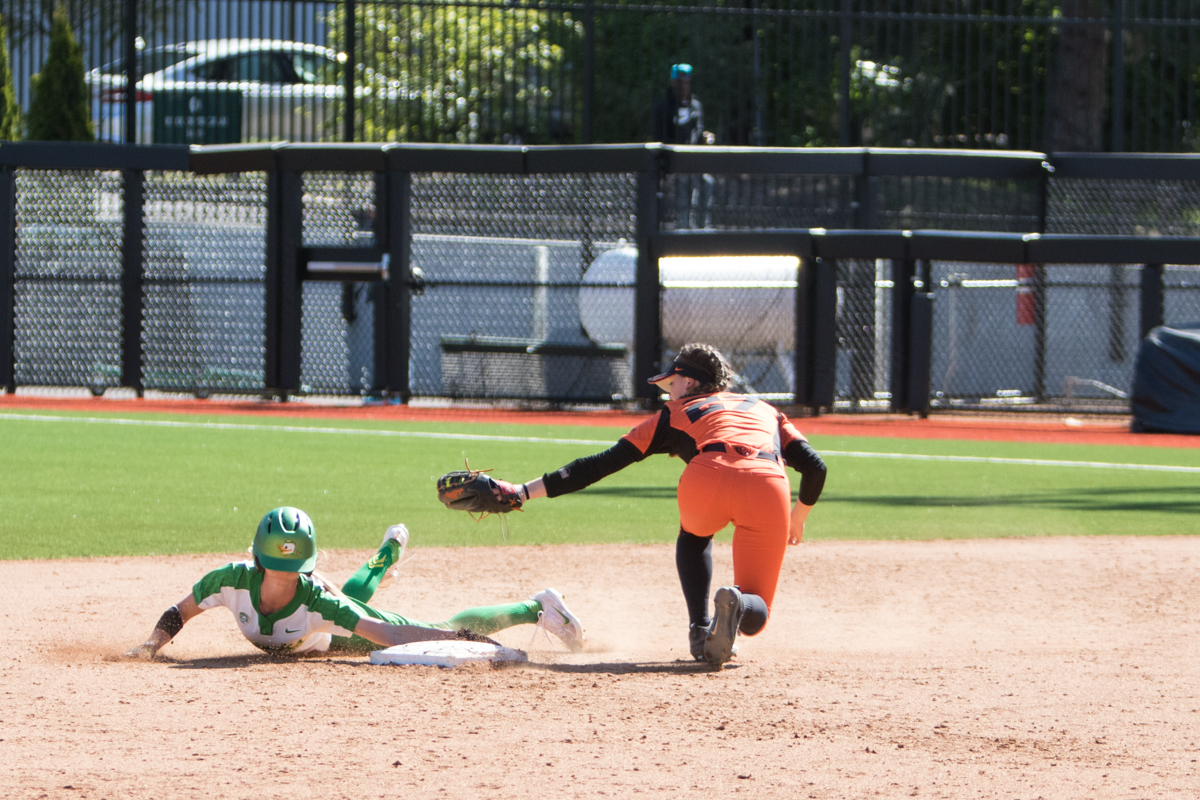 Oregon Ducks left fielder Alexis Mack (#10) narrowly avoids a tag out from Oregon State Beavers short stop McKenna Arriola (#27) during her slide into second. The Oregon Ducks defeated the Oregon State Beavers seven to zero on Sunday, April 30, 2017. The Ducks' victory marked the third victory of the three game sweep against the Beavers. Photo by Austin Hicks, Oregon News Lab