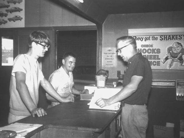 Family photo shows Ray Lambrecht, right, helping customers at the service counter.