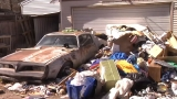 Landlord Forced to Remove Piles of Trash Engulfing Backyard