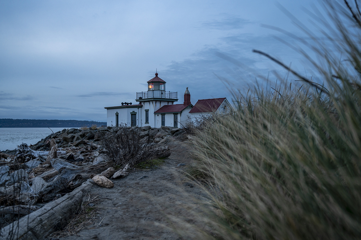 Nestled on a sandy point extending out into the Puget Sound, the West Point Light, commonly known as the Discovery Park Lighthouse, provides active navigation to Seattle's maritime traffic at West Point. (Image: Rachael Jones / Seattle Refined)