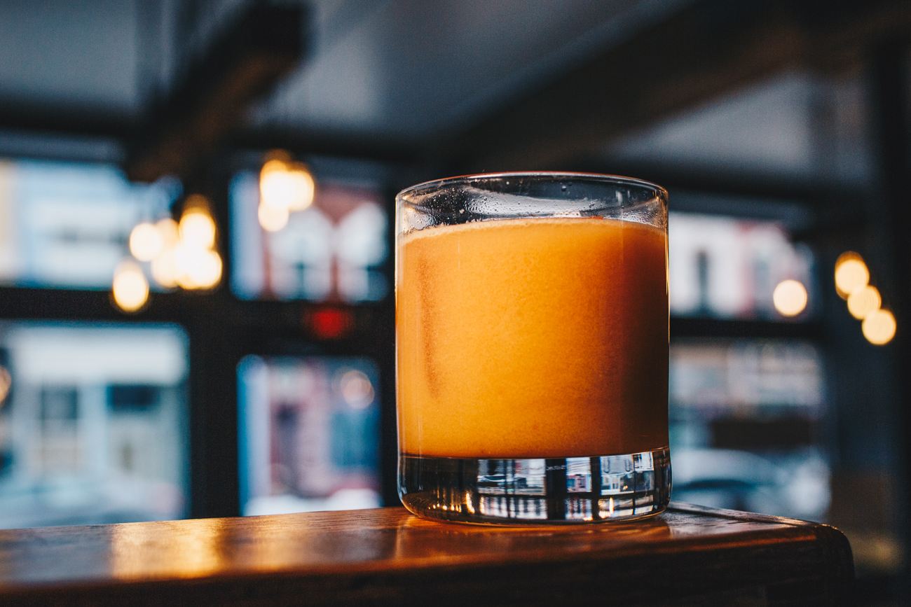 Daywalker: Buffalo Trace Bourbon, amaro, lemon, orgeat, persimmon apple Bbtters, soda, with a ginger blackberry ice cube / Image: Catherine Viox // Published: 2.25.19