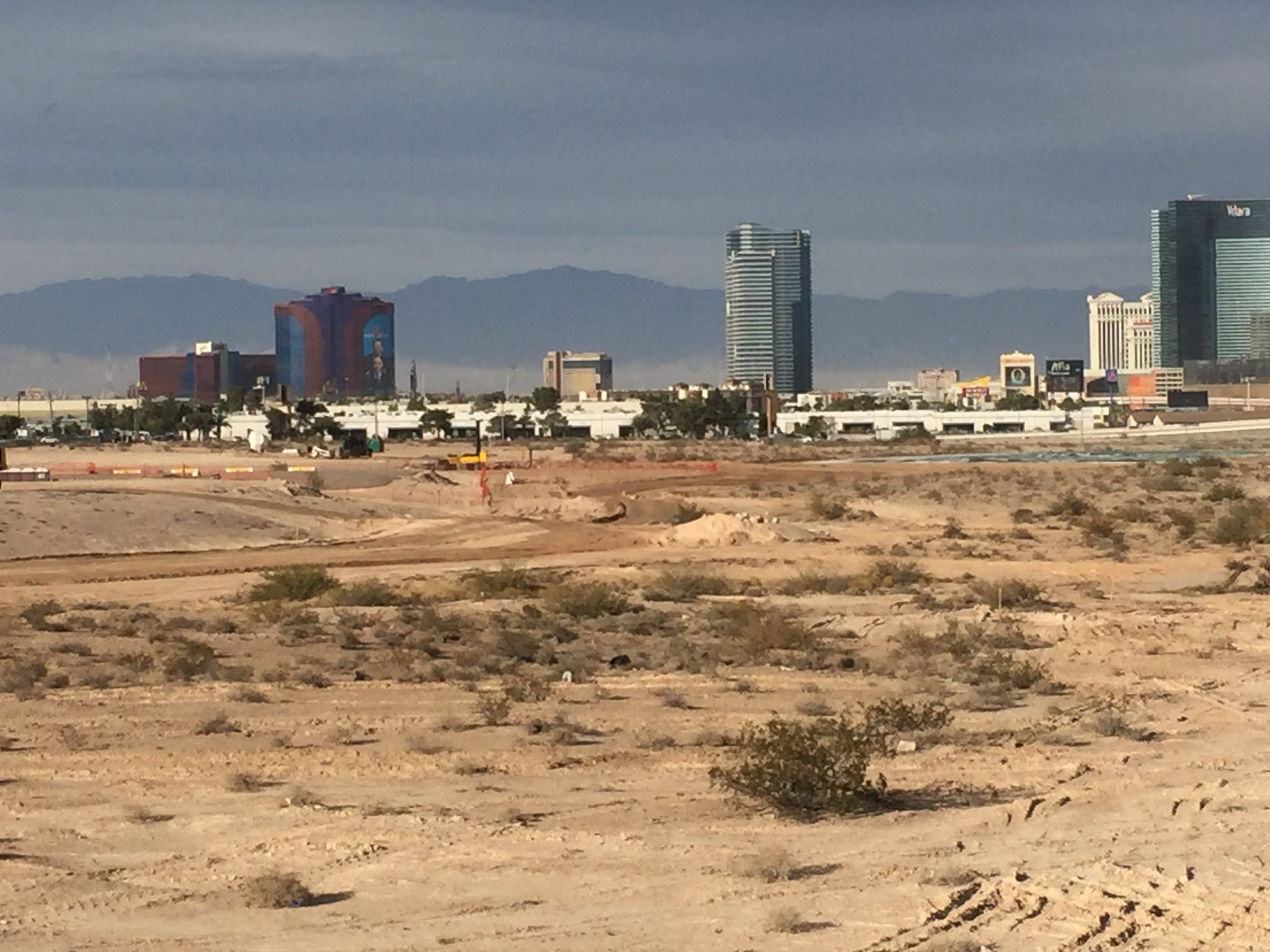 The groundbreaking tent is already gone. They're beginning to move dirt at the Raiders stadium site. (Jeff Gillan | KSNV)