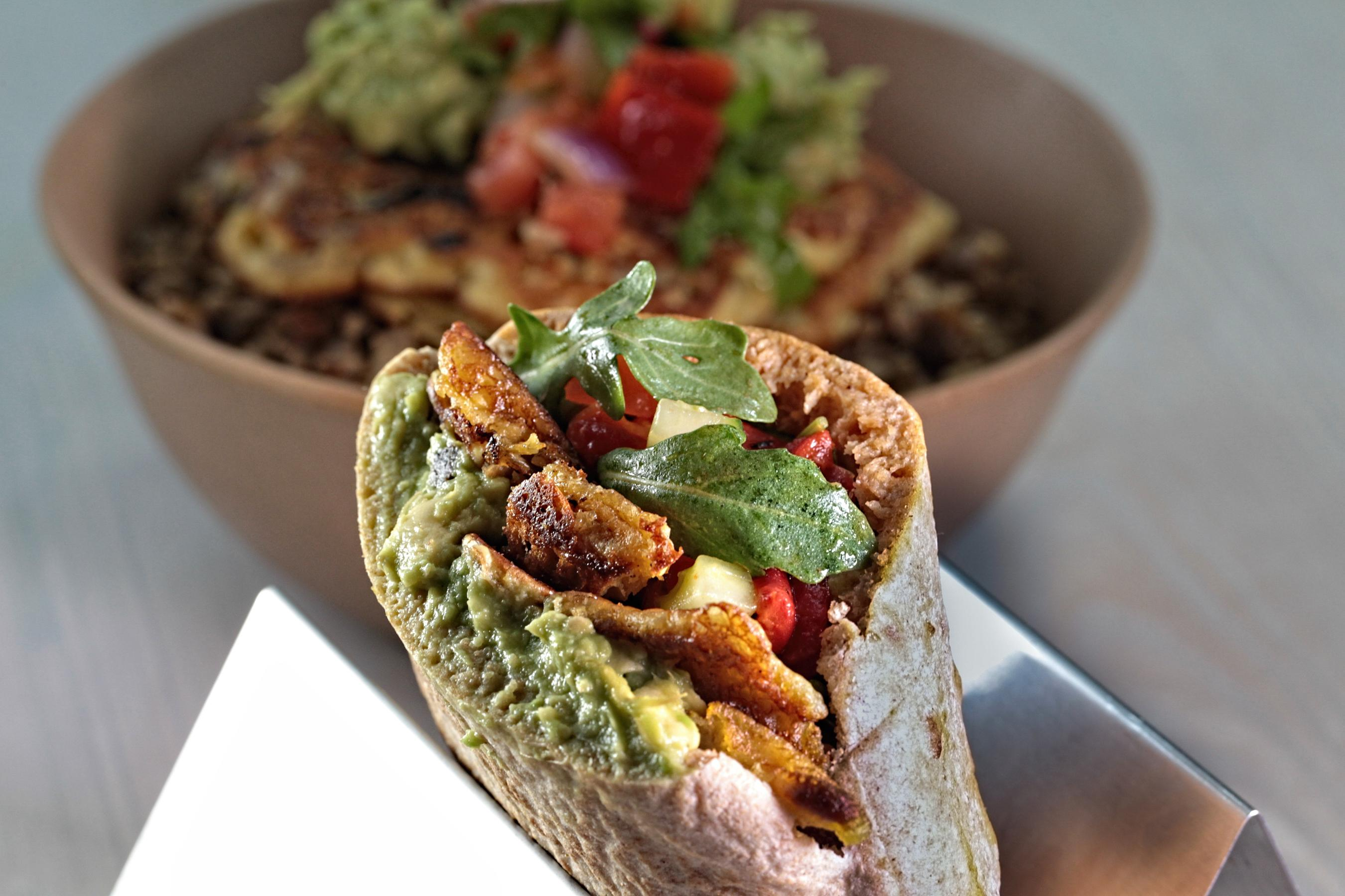 "Starting your morning with plant-based protein means you won't run out of steam by noon. The new breakfast pita at Shouk is stuffed with a hearty ""omelet"" of chickpea flour, mushroom, asparagus, potato, and onion. The pita is layered with avocado and a chopped salad of roasted red pepper, tomato, cucumber, onion, and arugula ($9.75). (Image: Courtesy Shouk)"