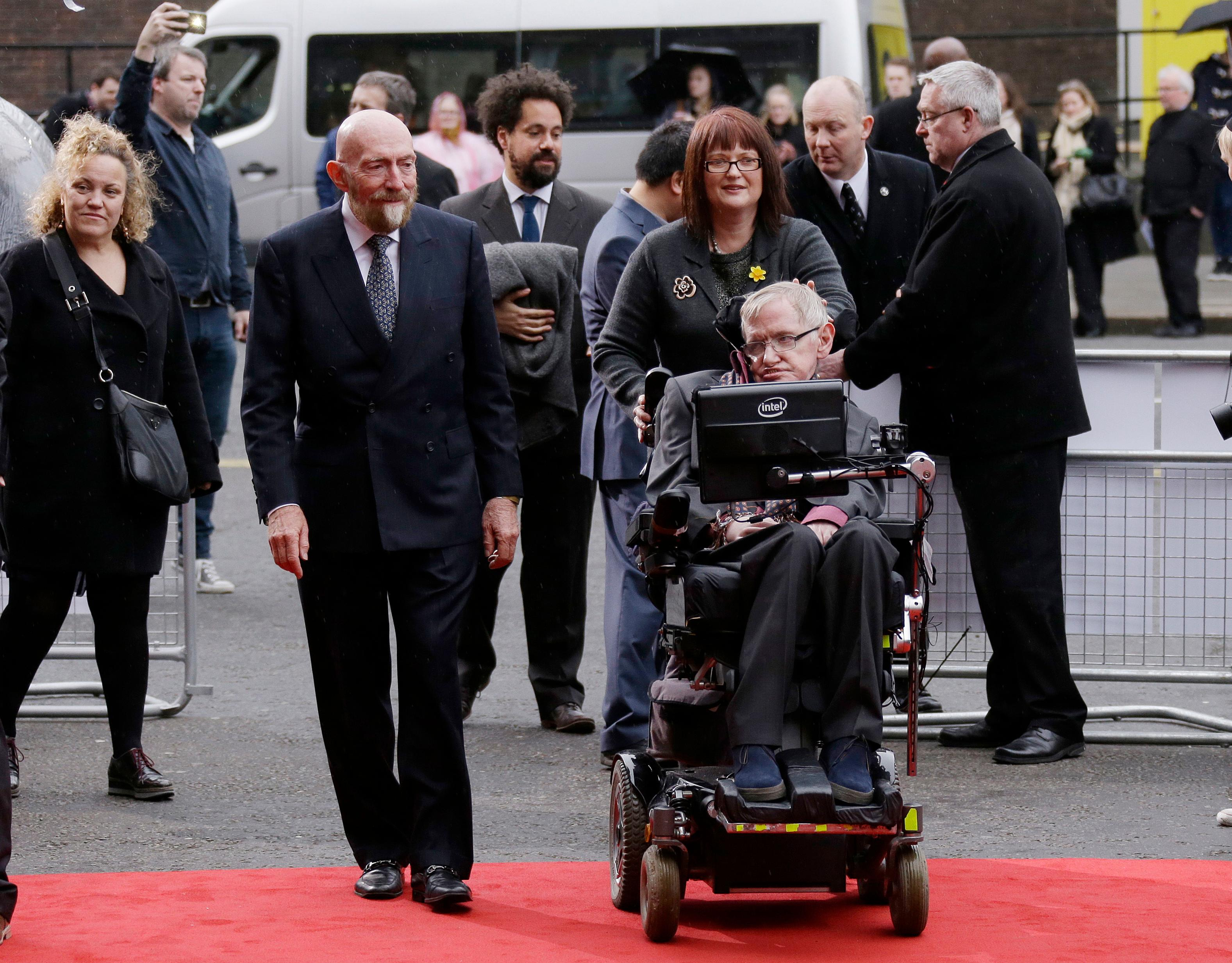 FILE - In this file photo dated Monday, 30 March, 2015, Professor Stephen Hawking, front right, and Professor Kip Thorne, left, arrive for the Interstellar Live show at the Royal Albert Hall in London. The Nobel Physics Prize 2017 is announced Monday Oct. 3, 2017, awarded jointly to three scientists Rainer Weiss of the Massachusetts Institute of Technology, and Barry Barish and Kip Thorne of the California Institute of Technology. (Photo by Joel Ryan/Invision/AP FILE)