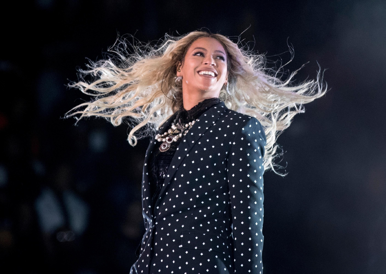 "FILE - In this Nov. 4, 2016 file photo, Beyonce performs at a Get Out the Vote concert for Democratic presidential candidate Hillary Clinton in Cleveland. The pop star is the leader of the 2017 Grammys with nine nominations, including bids for album of the year with ""Lemonade,"" and song and record of the year with ""Formation,"" announced Tuesday, Dec. 6. The singer, who already has 20 Grammys, is also the first artist to earn nominations in the pop, rock, R&B and rap categories in the same year. (AP Photo/Andrew Harnik, File)"