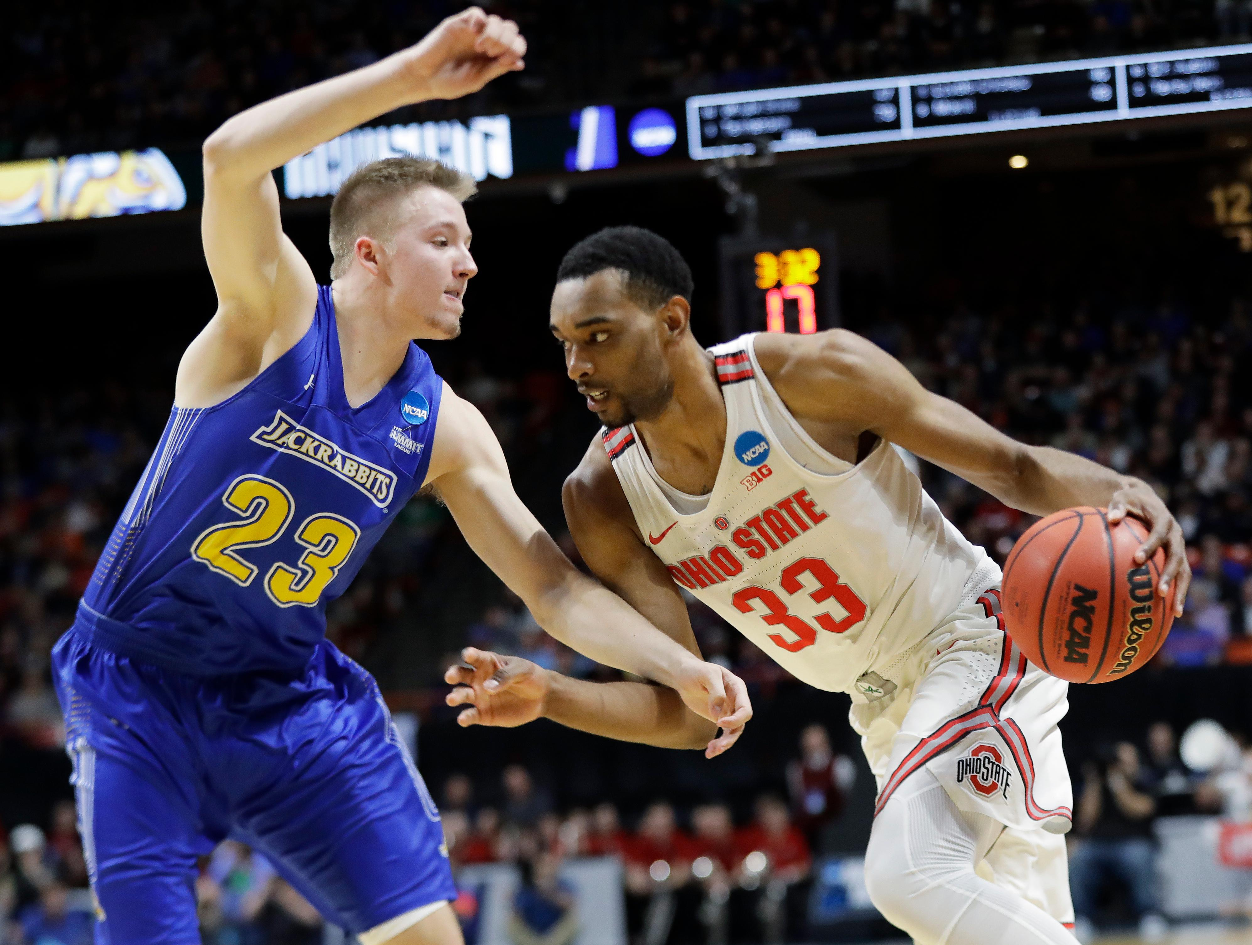 Ohio State forward Keita Bates-Diop (33) drives against South Dakota State guard Reed Tellinghuisen (23) during the first half of a first-round game in the NCAA college basketball tournament, Thursday, March 15, 2018, in Boise, Idaho. (AP Photo/Otto Kitsinger)