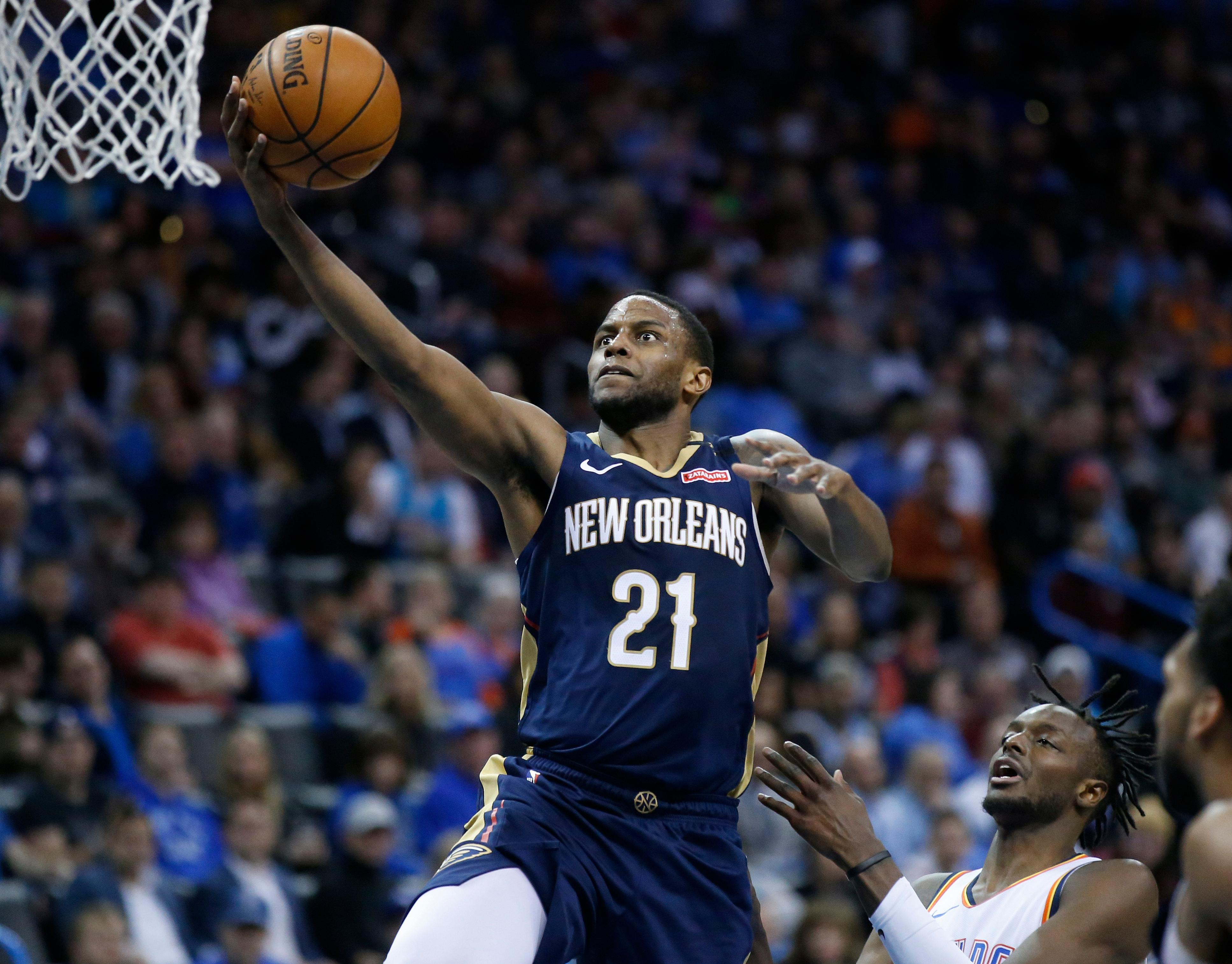 New Orleans Pelicans forward Darius Miller shoots in front of Oklahoma City Thunder forward Jerami Grant, right, during the first half of an NBA basketball game in Oklahoma City, Thursday, Jan. 24, 2019. (AP Photo/Sue Ogrocki)