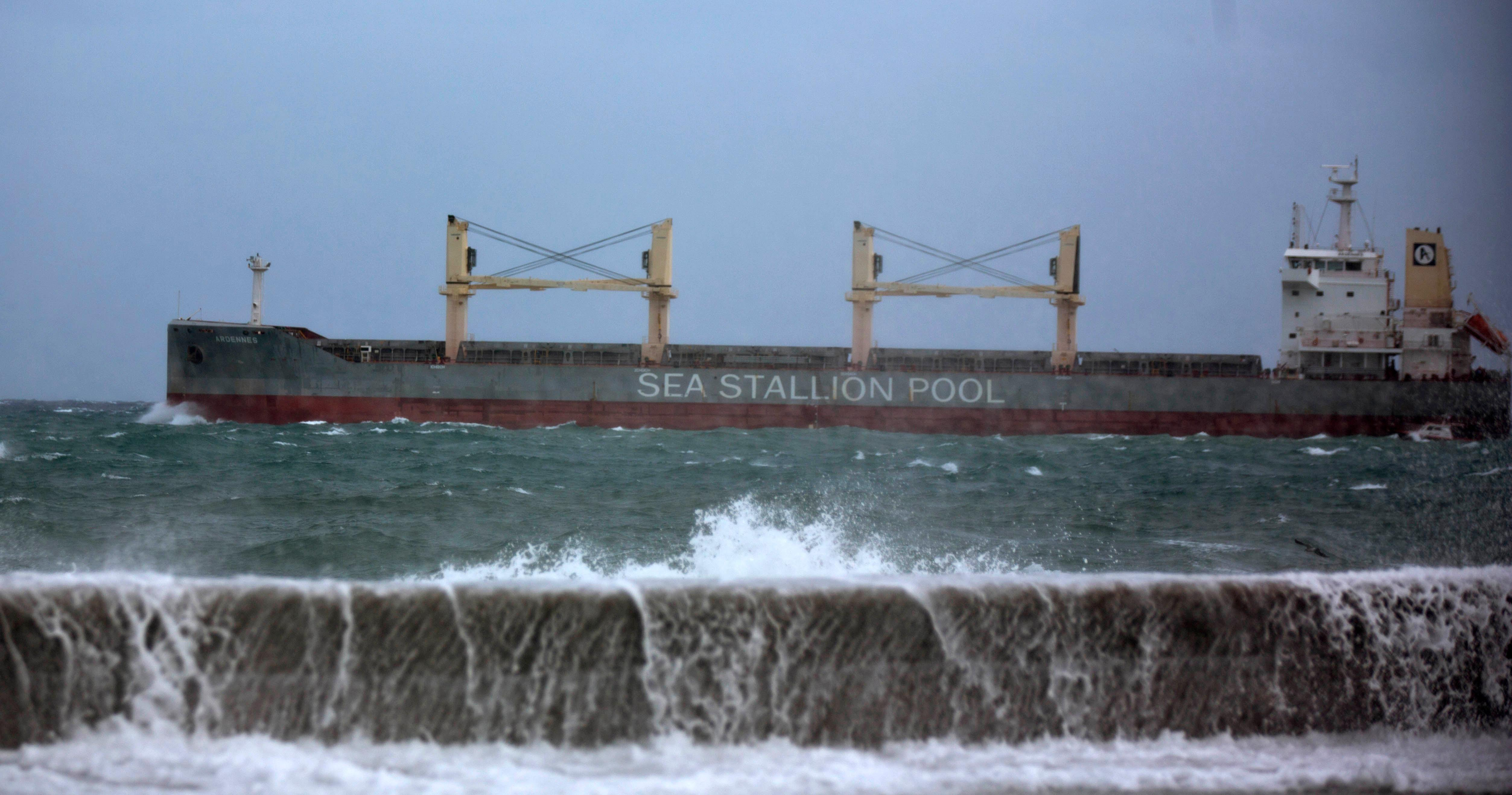 A sea wall is breeched by overflow as a bulk carrier leaves the bay of Havana, Cuba, Saturday, Sept. 9, 2017. There were no reports of deaths or injuries after heavy rain and winds from Hurricane Irma lashed northeastern Cuba. (AP Photo/Ramon Espinosa)