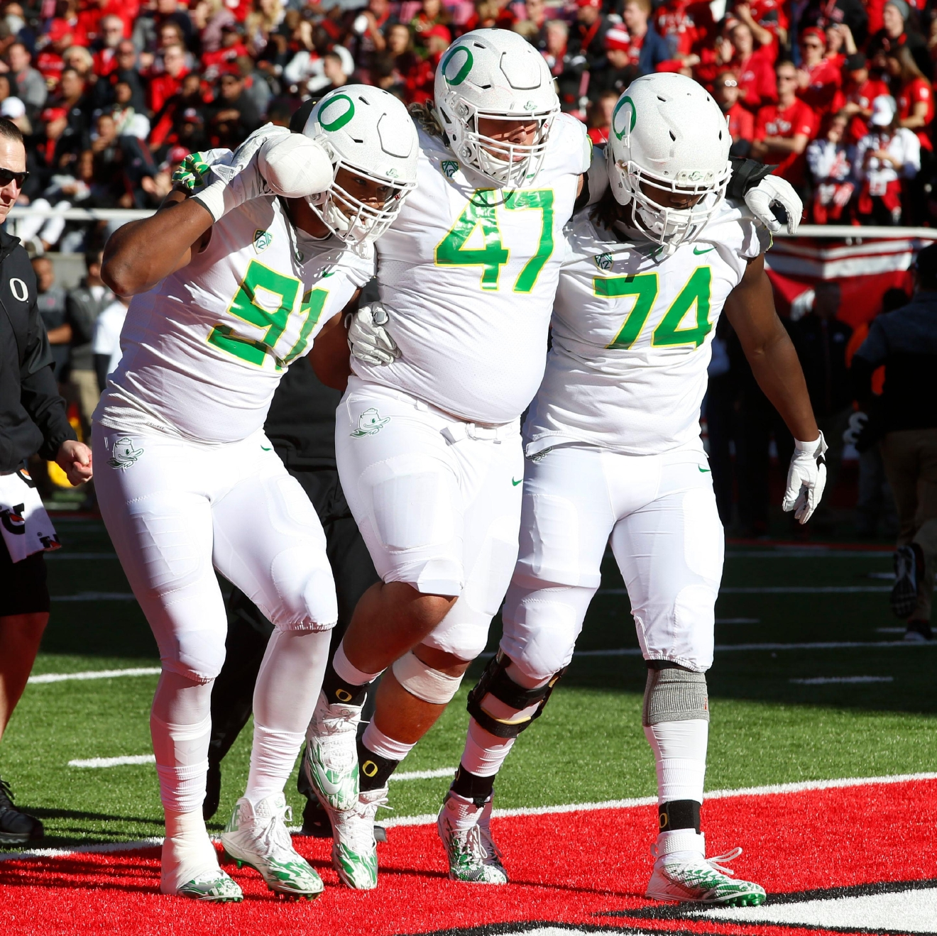 Oregon defensive lineman Rex Manu (47) is helped off the field after being injured by defensive lineman T.J. Daniel (91) and defensive lineman Elijah George (74) in the first half during an NCAA college football game, Saturday, Nov. 19, 2016, in Salt Lake City. (AP Photo/George Frey)