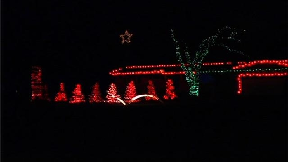 decorated house lights up to music and draws in the crowds weyi