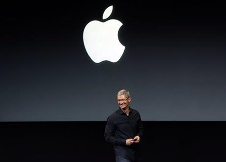 Apple CEO Tim Cook speaks on stage before a new product introduction in Cupertino, Calif., Tuesday, Sept. 10, 2013.