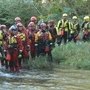 Rescue workers practice swift water rescues in the mountains