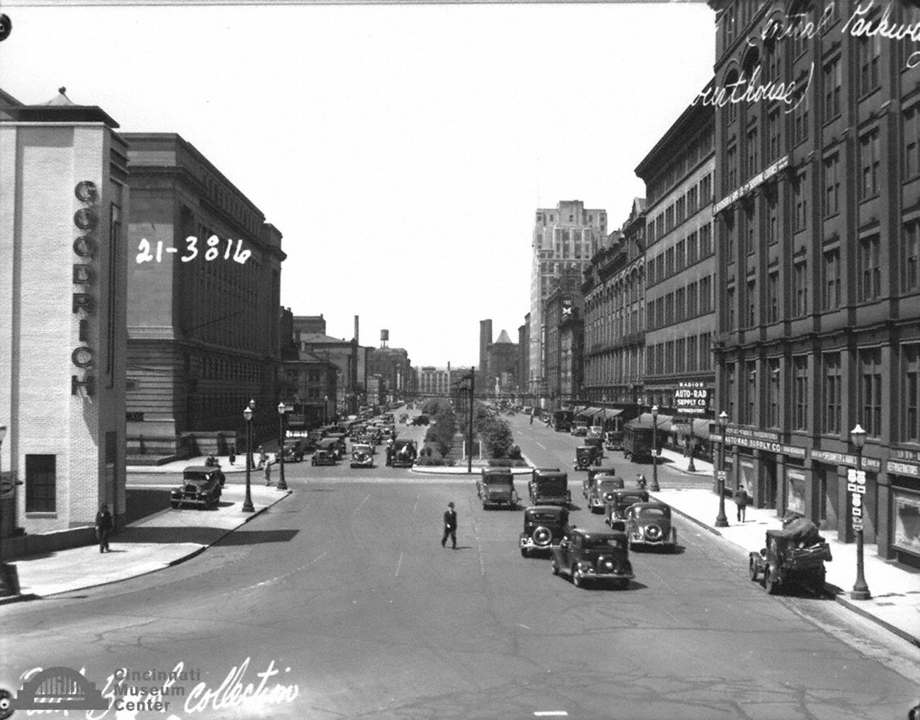 Pictured: Looking west on Central Parkway from Broadway Street during an unknown year / Paul Briol is an iconic Cincinnati photographer who captured the city's buildings, documented the construction of ambitious projects, and captured people in their daily routines and careers from the early 20th Century. He sought to show a true reflection of the world around him, rather than a touched up, glamorized version. His work is a true reflection of Cincinnati's history, which became well-regarded with the publication of his photo book titled City of Rivers and Hills in 1925. / Image: Paul Briol, accessed via the Cincinnati Museum Center History Library and Archives{ }// Published: 2.16.19