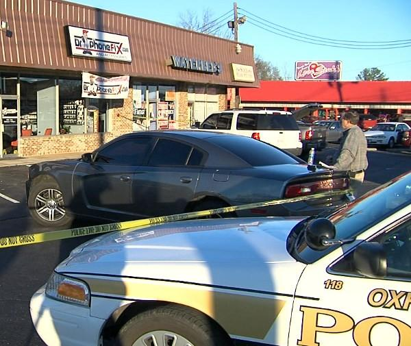 A man was shot and killed inside a cell phone repair shop after pulling a knife on Oxford Police officers on Friday, January 18, 2013.