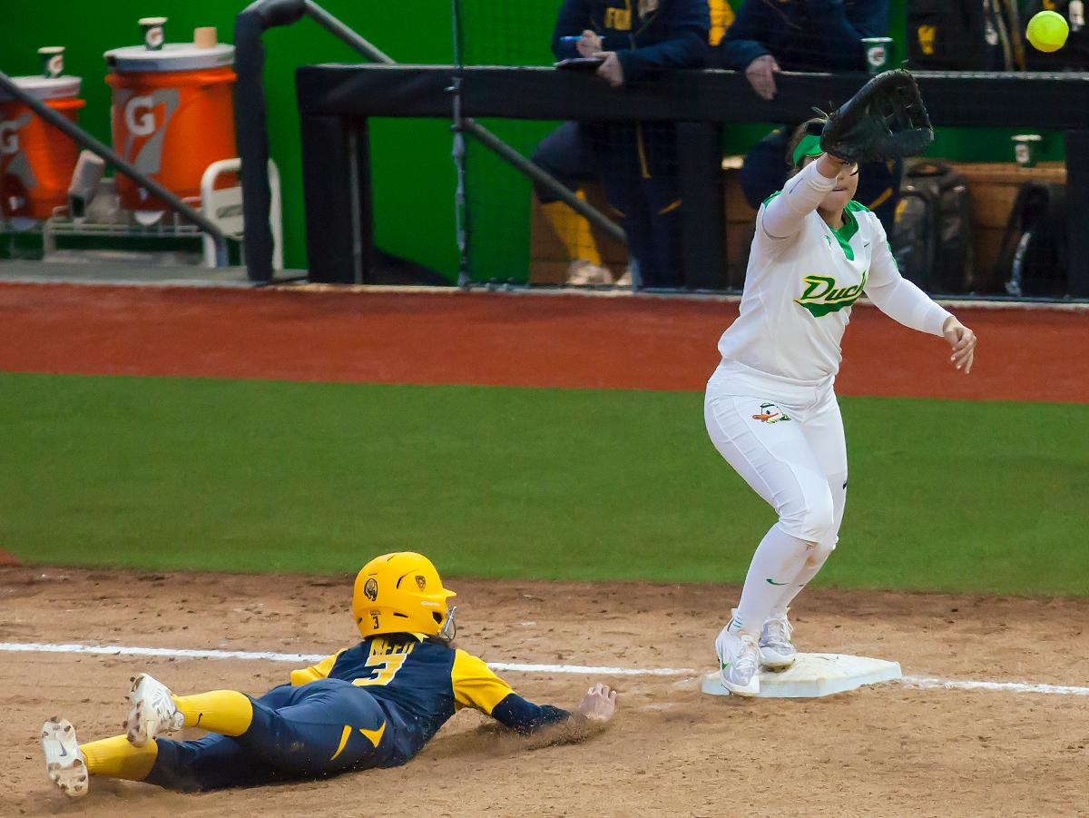 Oregon infielder Mia Camuso (#7) catches the ball to tag out California infielder Lindsay Rood. In the first of a three game series the Oregon Ducks defeated the California Golden Bears five to one. Photo by Ben Lonergan, Oregon News Lab
