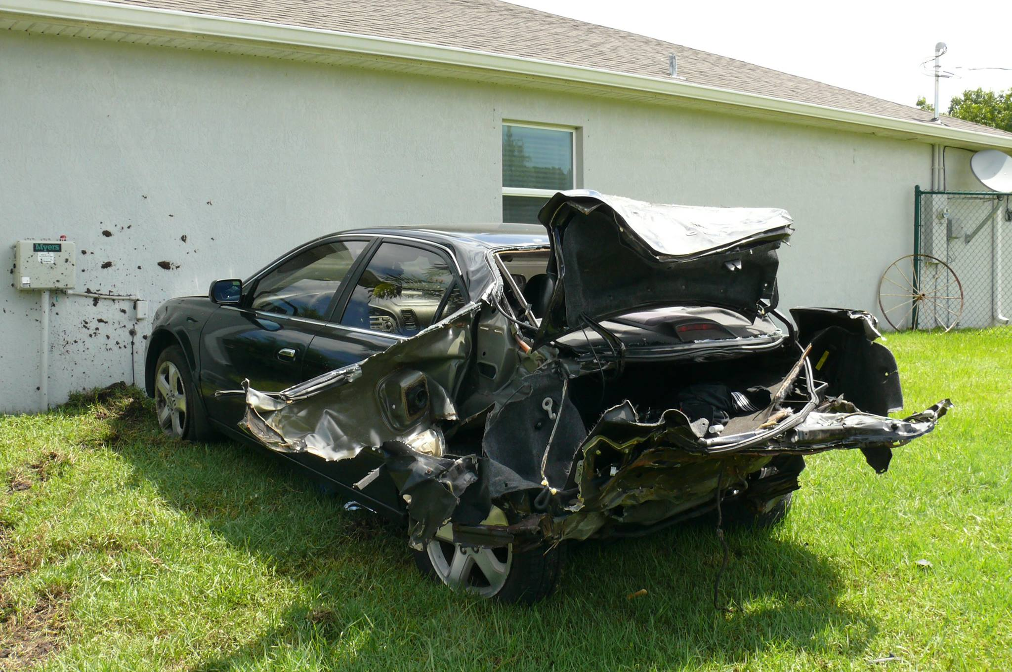 Police are investigating a car crash which landed both cars on residential lawns.  (PSLPD)