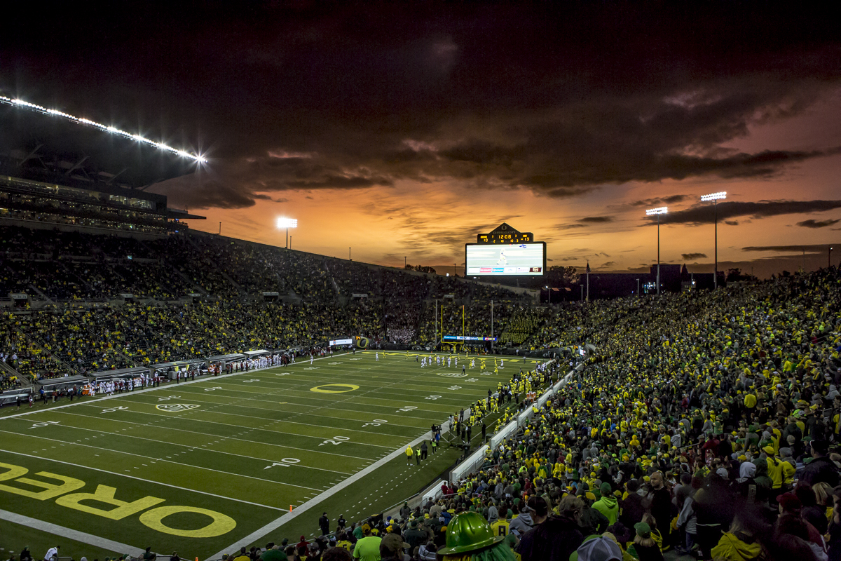 The sun sets over Autzen Stadium. The Oregon Ducks trail the Washington State Cougars 10 to 13 at the end of the first half. Photo by Ben Lonergan, Oregon News Lab