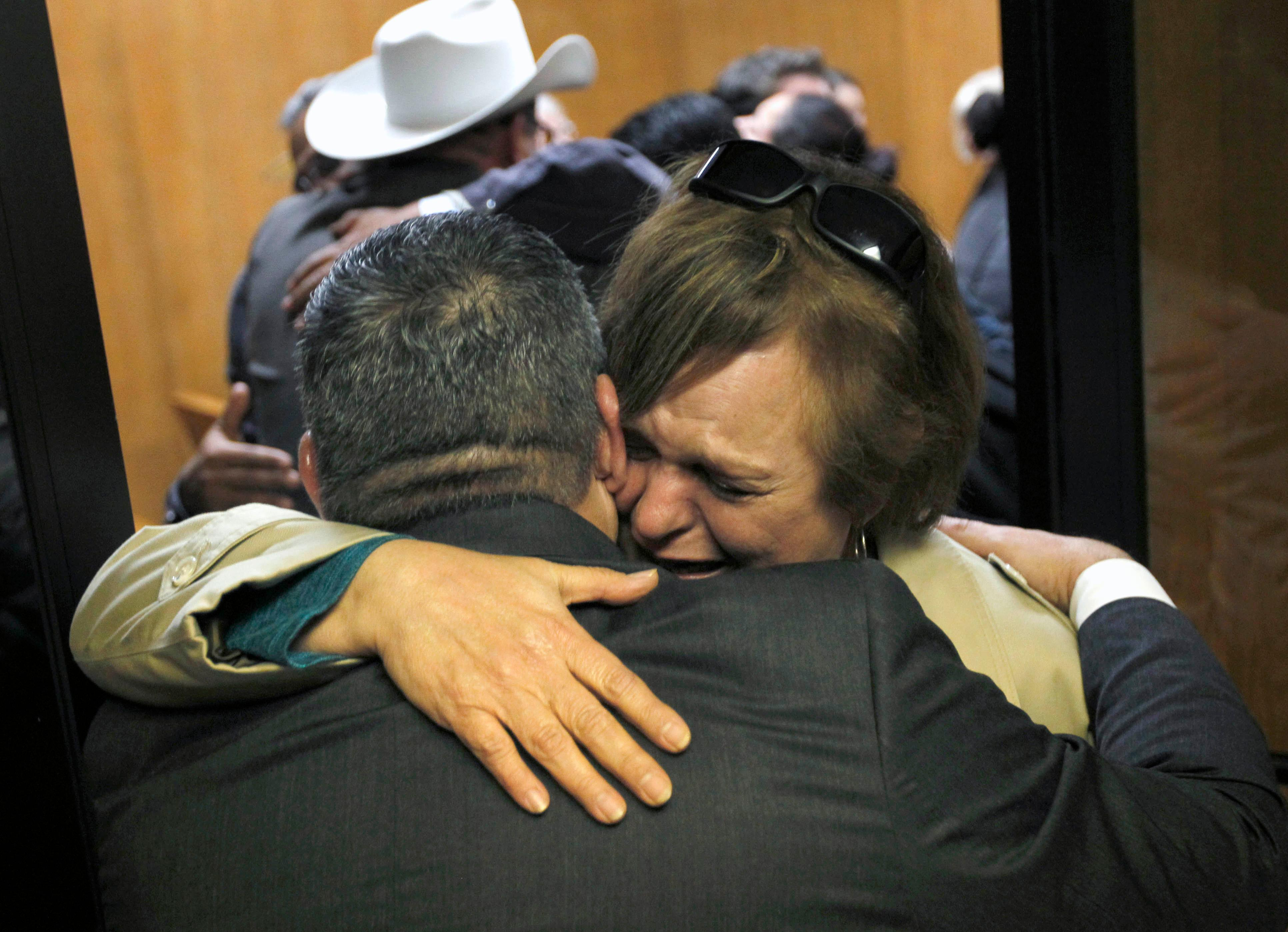 Noemi Sigler hugs Hidalo County Assistant District Attorney Michael Garza following the guilty verdict in John Bernard Feit's trial for the 1960 murder of Irene Garza in the 92nd state District Court Thursday, December 7, 2017, at the Hidalgo County Courthouse in Edinburg. Sigler is a relative of Irene Garza.  (Nathan Lambrecht/The Monitor/Pool)