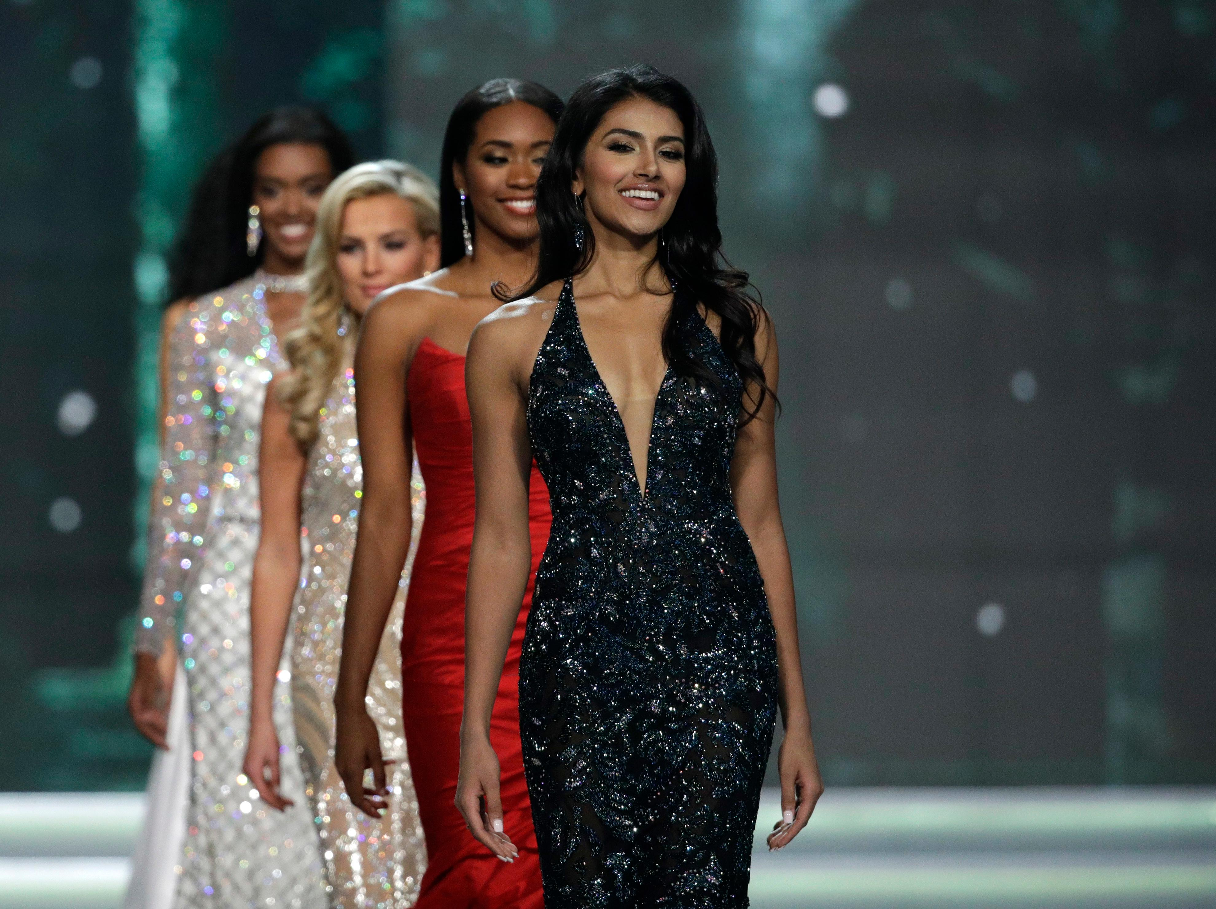 Miss New Jersey USA Chhavi Verg walks up the stage during the Miss USA contest Sunday, May 14, 2017, in Las Vegas. (AP Photo/John Locher)