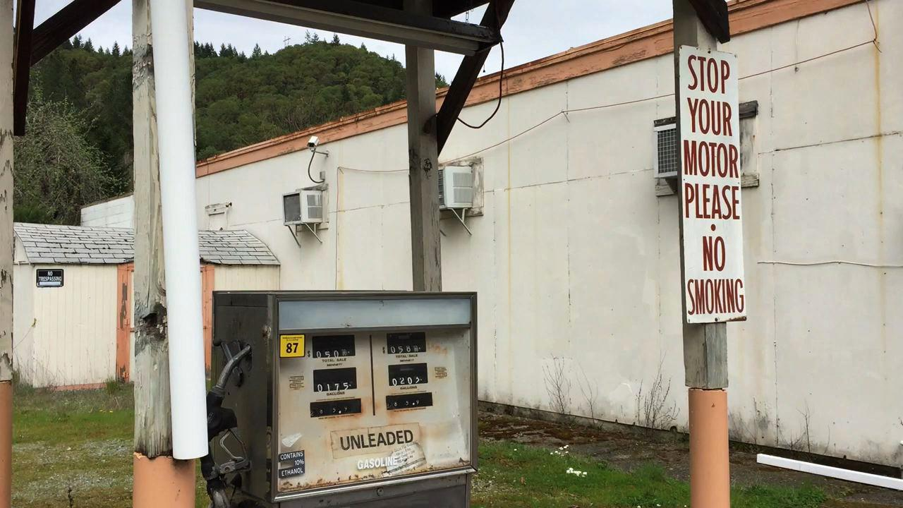 In this April 5, 2017 image taken from video, a gas pump stands abandoned, the price frozen in time, in downtown Tiller, Ore. Tiller, a dot on a map in remote southwestern Oregon, is for sale for $3.5 million, including the gas station, and the elementary school is for sale separately for $350,000. (AP Photo/Gillian Flaccus)