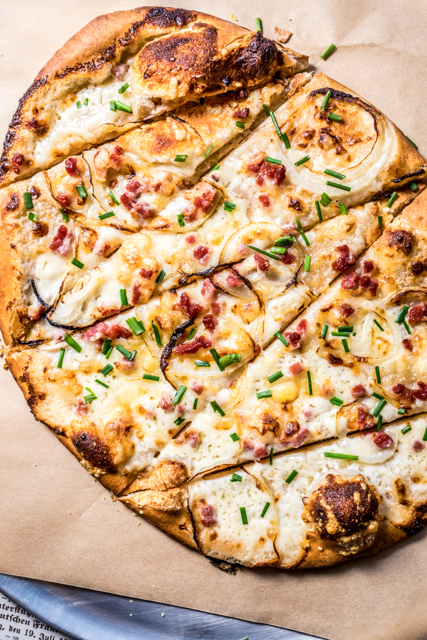 Flammekueche: a southwestern German style pizza on sourdough topped with crème fraîche, thinly sliced onions, Swiss cheese, and black forest ham / Image: Catherine Viox // Published: 12.17.19