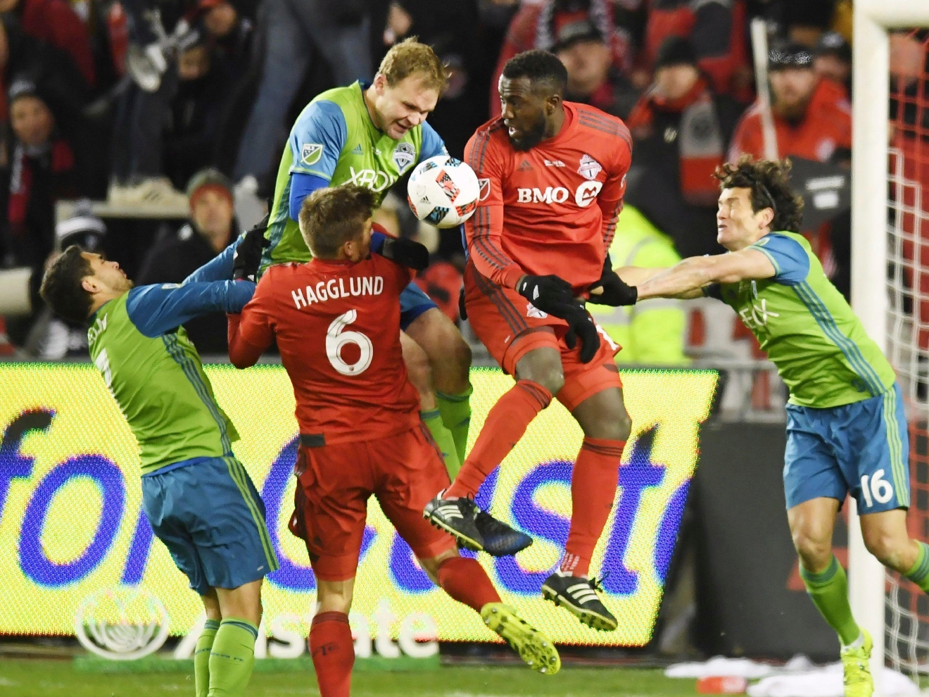 Toronto FC forward Jozy Altidore (17) and Seattle Sounders defender Chad Marshall (14) go up to head the ball as Toronto FC defender Nick Hagglund (6), Sounders midfielder Cristian Roldan (7) and forward Nelson Haedo Valdez (16) look on during second-half MLS Cup final soccer action in Toronto, Saturday, Dec. 10, 2016. (Frank Gunn/The Canadian Press via AP)