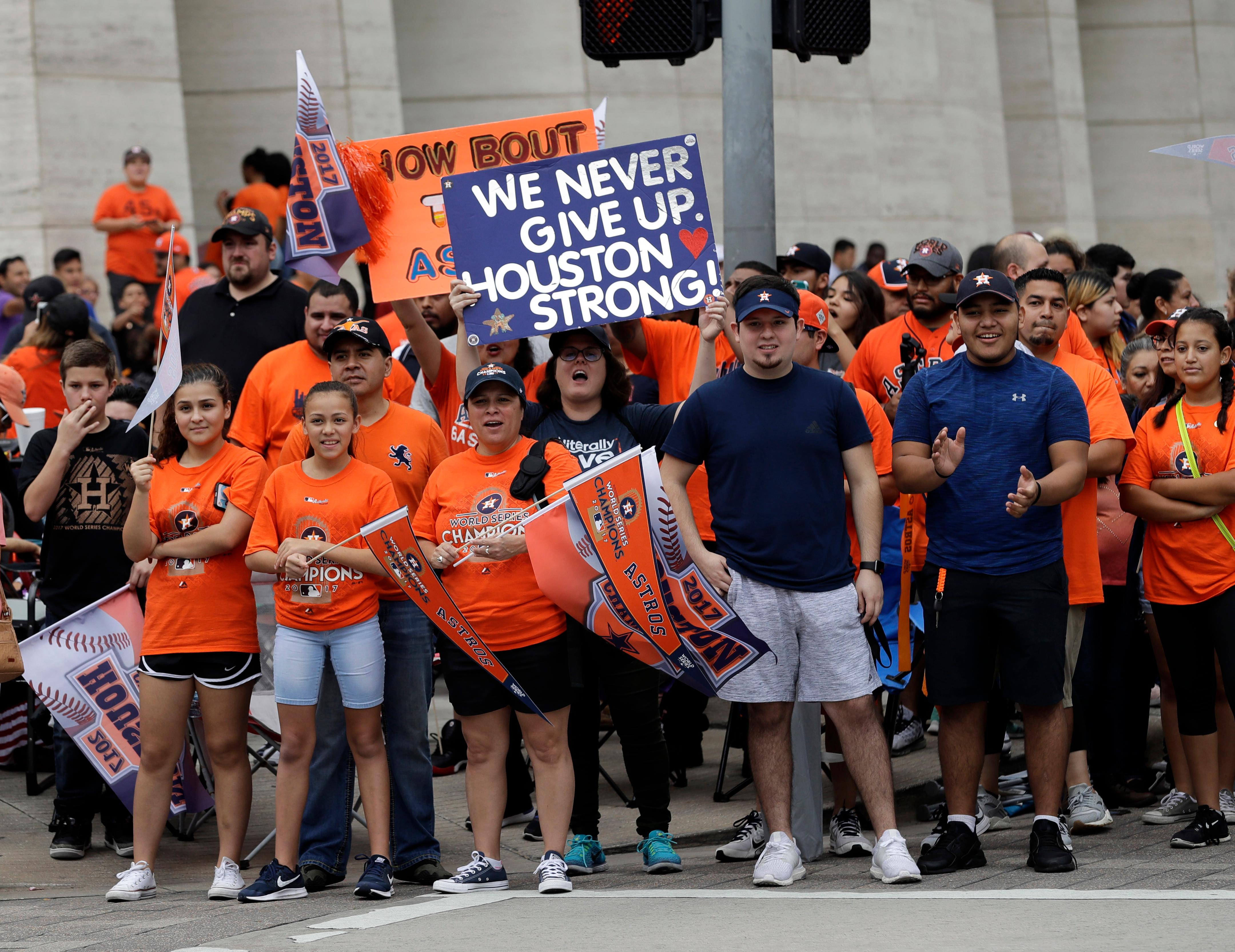 Houston Astros fans celebrate before a parade honoring the World Series baseball champions Friday, Nov. 3, 2017, in Houston. (AP Photo/David J. Phillip)