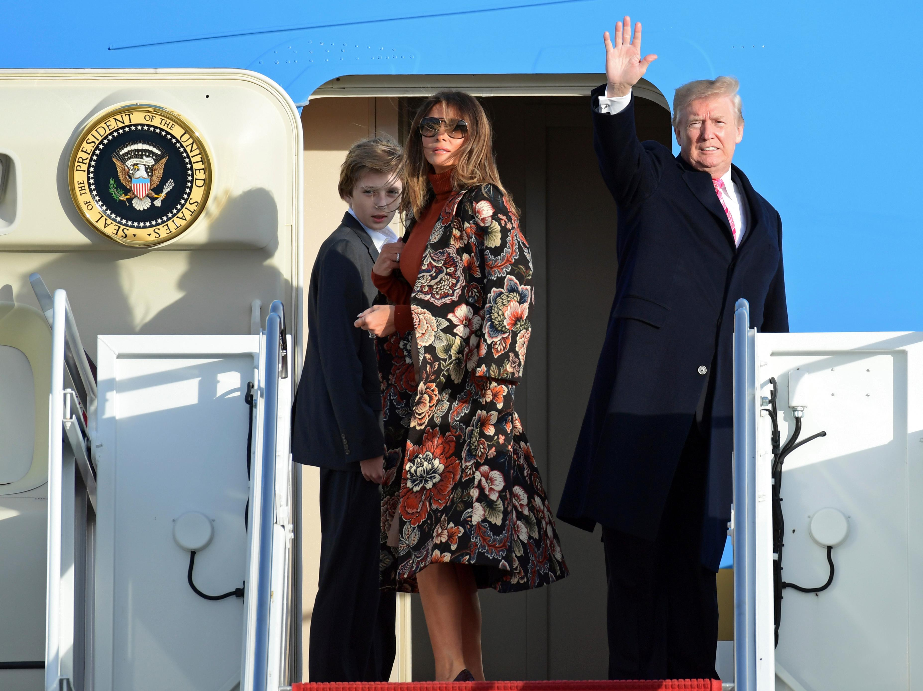 President Donald Trump, right, first lady Melania Trump, center, and their son Barron Trump, left, stand at the top of the stairs of Air Force One at Andrews Air Force Base in Md., Tuesday, Nov. 21, 2017. The Trump's are going to Mar-a-Lago in Palm Beach, Fla., for the Thanksgiving holiday. (AP Photo/Susan Walsh)