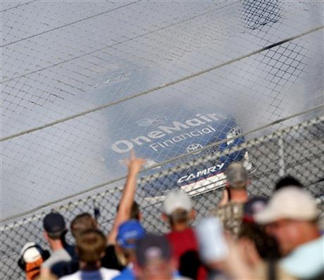 Elliott Sadler celebrates winning the NASCAR Aaron's 312 Nationwide series auto race as fans cheer at Talladega Superspeedway, Saturday, May 3, 2014, in Talladega, Ala.