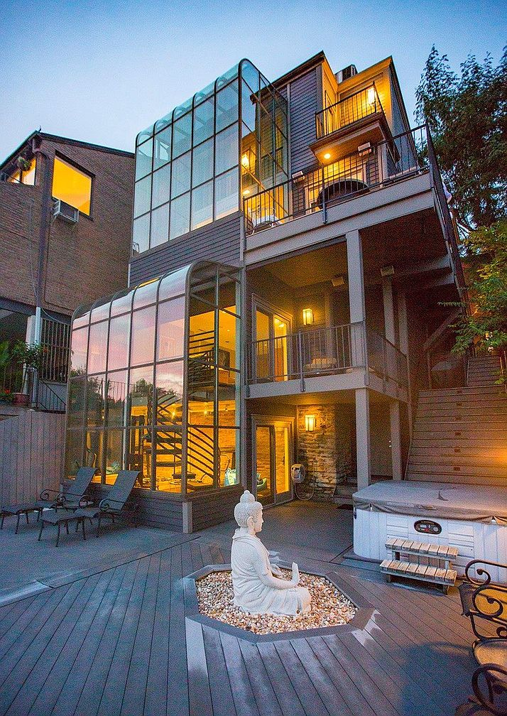 909 Riverview Place in Mt. Adams in $1,385,000 / With close proximity to Downtown on a semi-secluded lot in Mt. Adams, 909 Riverview Place feels both private and in the thick of things at the same time. The entire back of the house sports two glass atriums that invite loads of afternoon and evening light into the house. The home, which is understood to have been built in the 1880s, is up to date with modern appliances and finishes, too. / Our favorite feature: Show me a house with two glass atriums better than this one and I'll eat my hat. / Image: Ross Van pelt // Published: 1.9.20