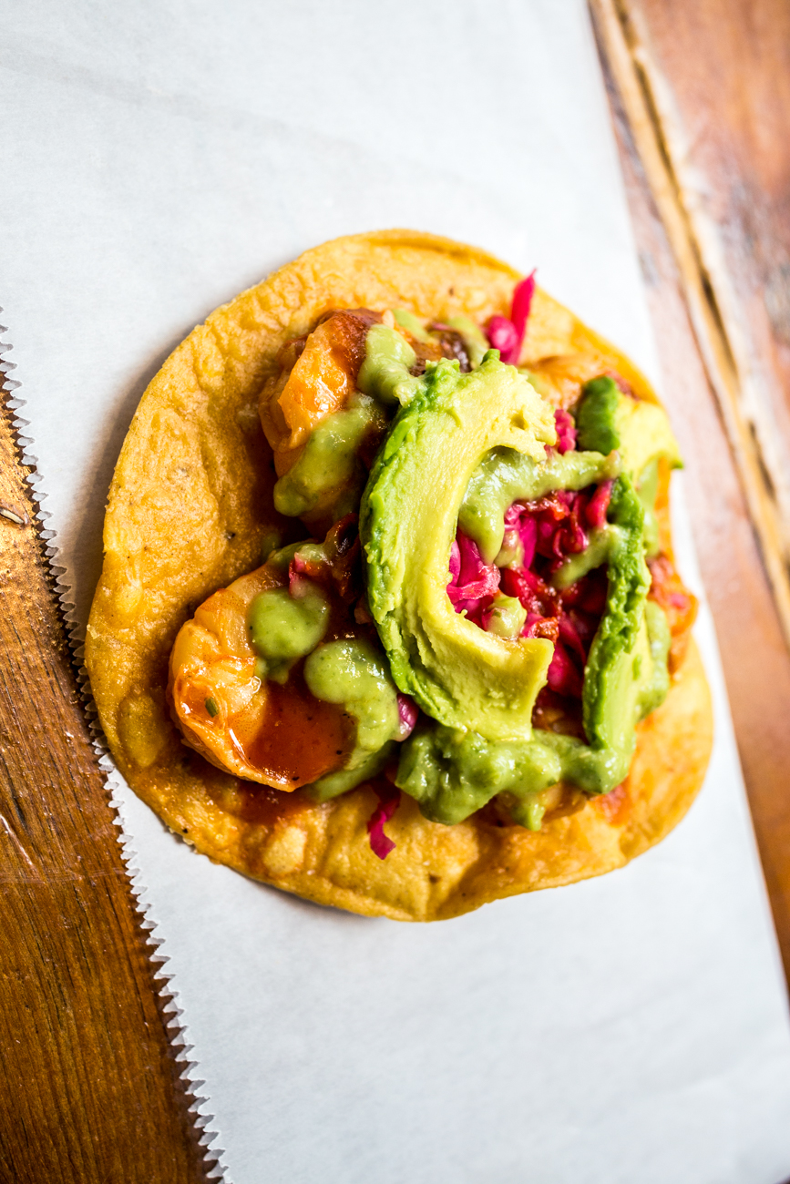 Camarones (Shrimp) Tostada: crispy corn tortilla topped with shrimp, avocado salsa, salsa de tamarindo, pickled red cabbage, and fresh avocado / Image: Catherine Viox // Published: 8.31.19