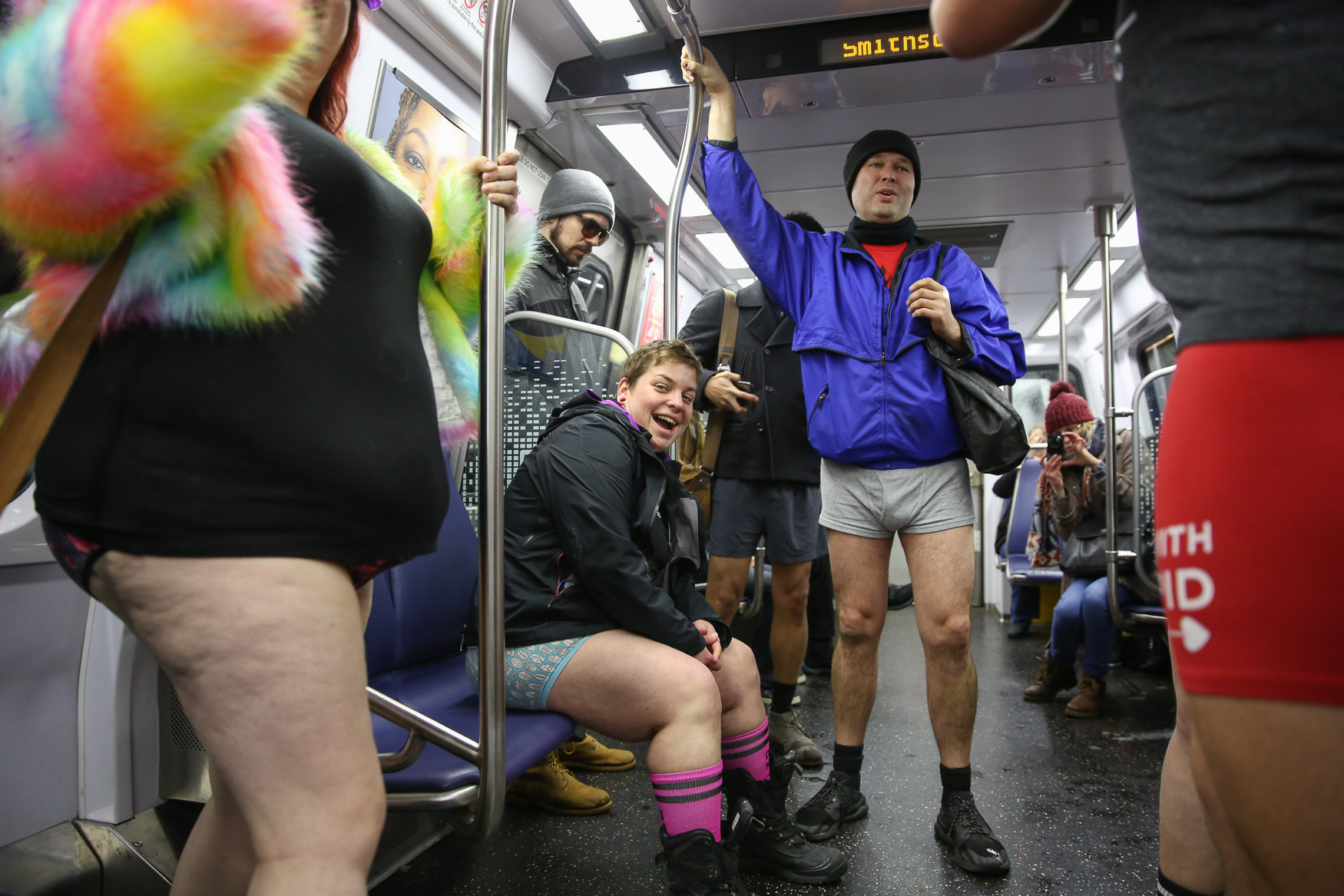 Over a dozen people braved the snow and stripped down for the annual 'No Pants Metro Ride' on January 13. The event is a spin-off of a similar event in New York, but D.C.'s is smaller. The riders boarded at L'Enfant Metro Station and ventured all over town before settling at The Big Hunt in Dupont for their pants option after-party. (Amanda Andrade-Rhoades/DC Refined)