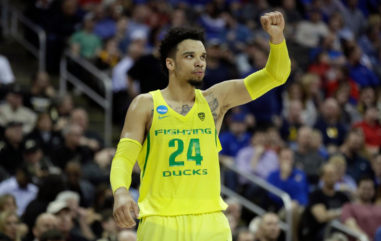 Oregon forward Dillon Brooks celebrates at the end of a regional semifinal against Michigan in the NCAA men's college basketball tournament, Thursday, March 23, 2017, in Kansas City, Mo. Oregon won 69-68. (AP Photo/Charlie Riedel)
