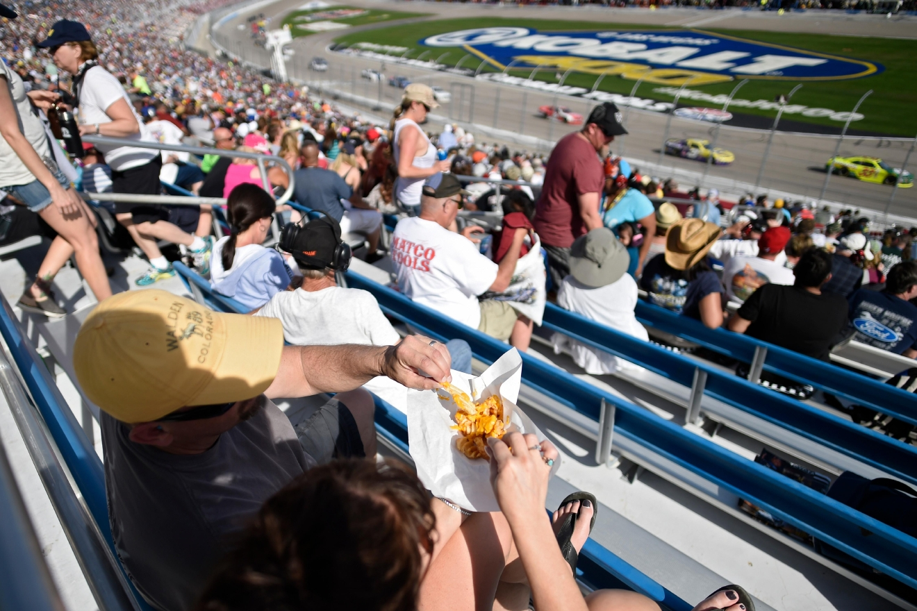 A couple shares cheesy fries during the NASCAR Xfinity Series Boyd Gaming 300 Saturday, March 11, 2017, at the Las Vegas Motor Speedway. (Sam Morris/Las Vegas News Bureau)