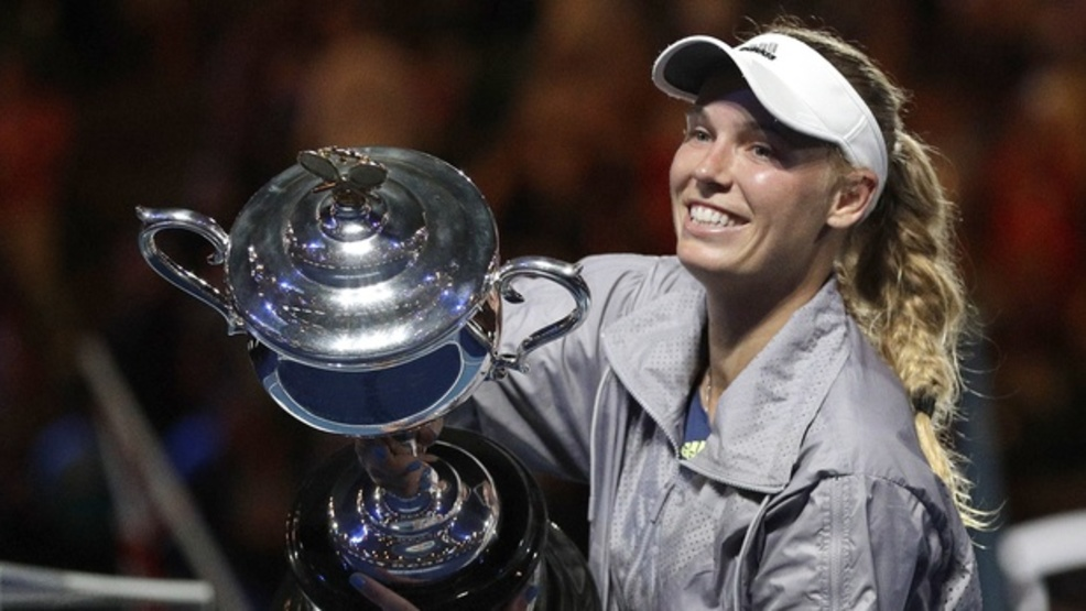 Caroline Wozniacki defeated Simona Halep in three close sets to win her first Grand Slam title. (AP)