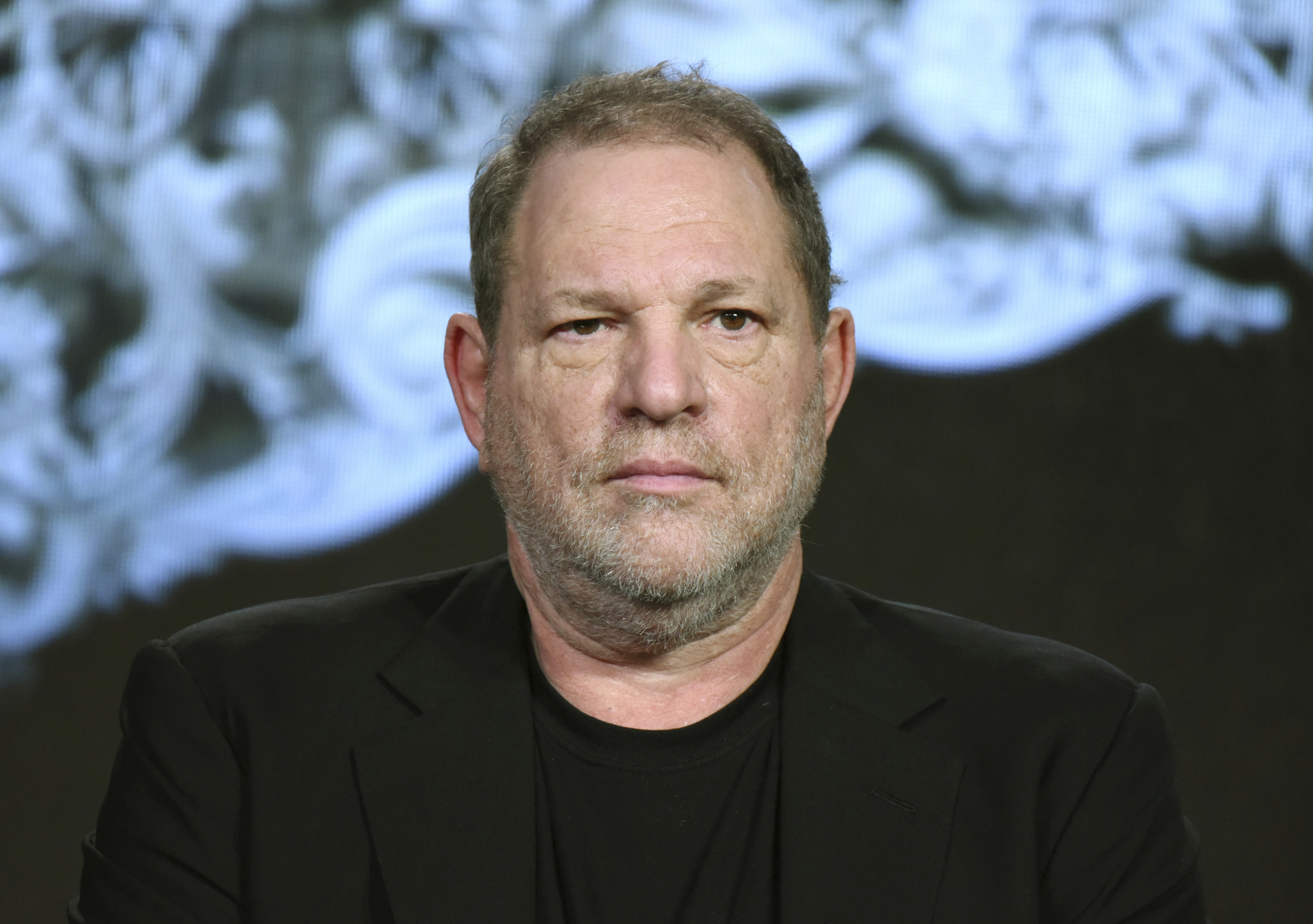 "CORRECTS FROM SUSPENDED TO INDEFINITE LEAVE - FILE - In this Jan. 6, 2016 file photo, producer Harvey Weinstein participates in the ""War and Peace"" panel at the A&E 2016 Winter TCA in Pasadena, Calif. Weinstein is on indefinite leave from his film company pending an internal investigation into sexual harassment claims leveled against the Oscar winner. The decision was announced by The Weinstein Co.'s board of directors. (Photo by Richard Shotwell/Invision/AP, File)"