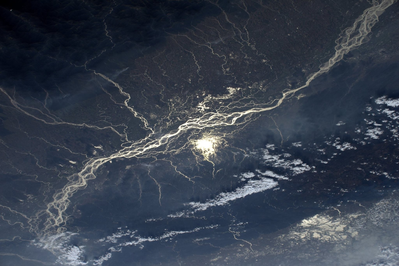 The Sun is reflected on the ramifications of the river brahmaputra river in India  (Photo & Caption: Thomas Pesquet // NASA)