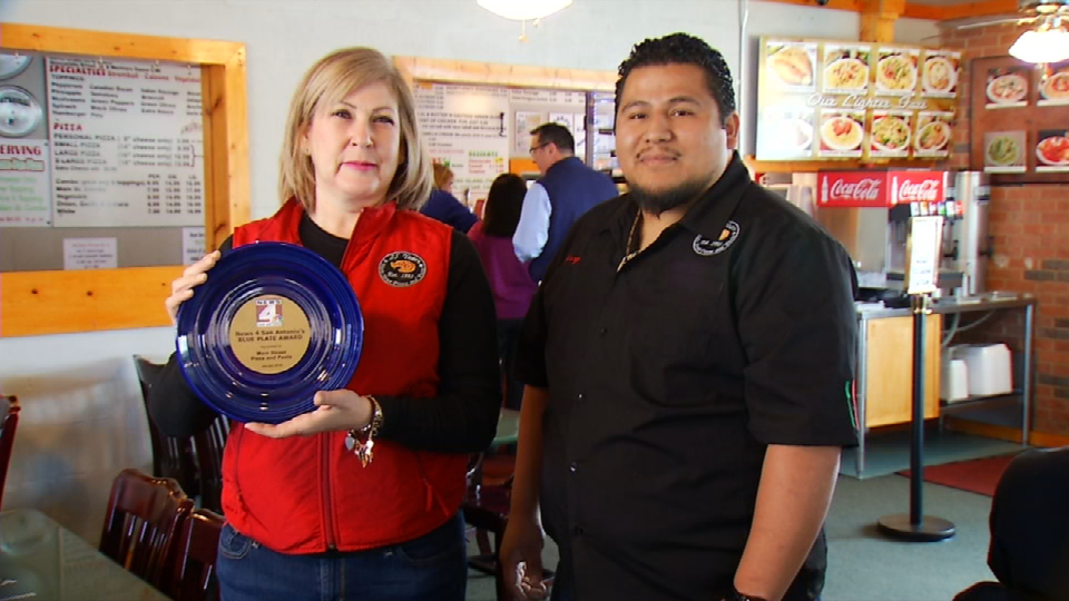 Here we have Jo Ann Garza, the restaurant owner, with the restaurant manager Jerry, holding their Blue Plate Award. (News 4 San Antonio)<p></p>