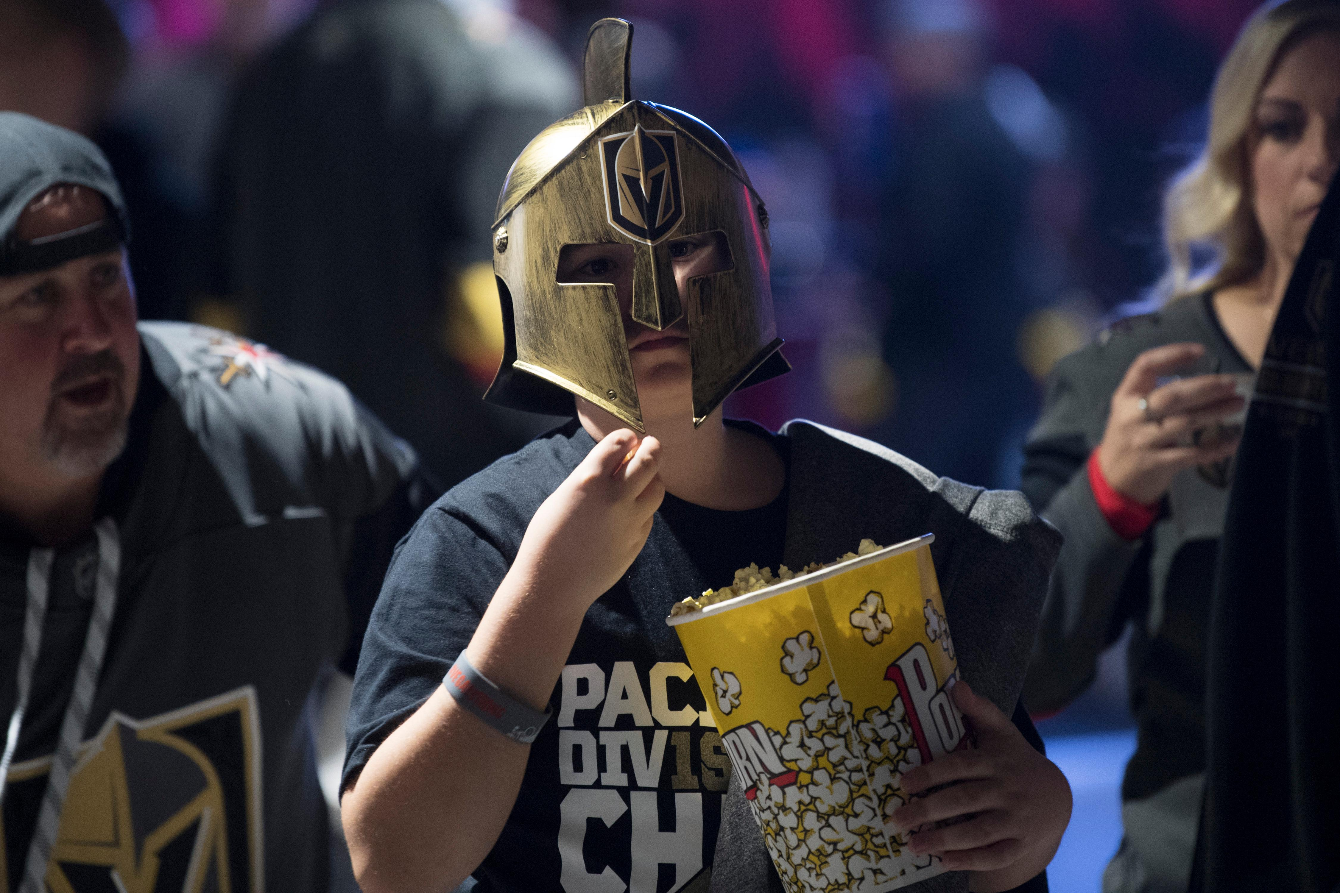 Gavyn Revelle munches popcorn between the first and second period of Game 1 of their NHL hockey first-round playoff series between the Vegas Golden Knights and the Los Angeles Kings Wednesday, April 11, 2018 at T-Mobile Arena. The Knights won 1-0. CREDIT: Sam Morris/Las Vegas News Bureau