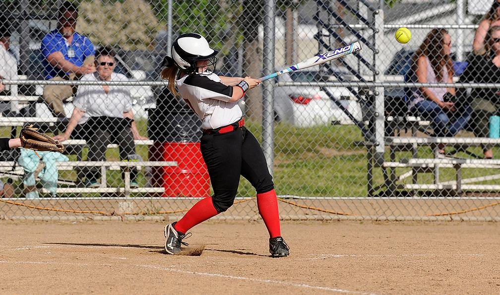 Andy Atkinson / Mail Tribune - North's Lily Gann gets a hit in the 5th inning.