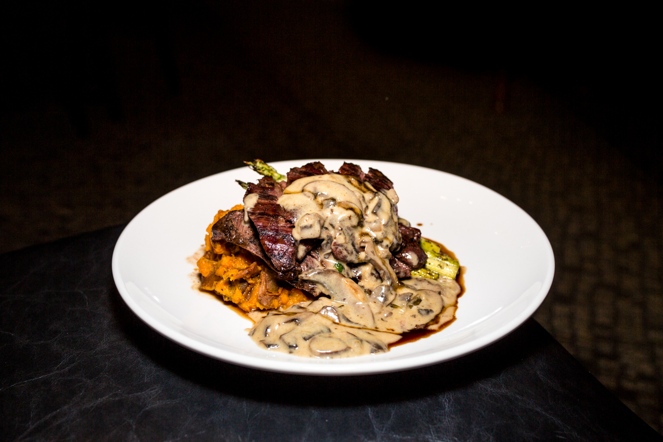 Skirt steak: mashed sweet potatoes, crispy carrot, saba, wood-grilled asparagus, and mushroom ragu / Image: Catherine Viox{ }// Published: 9.5.19