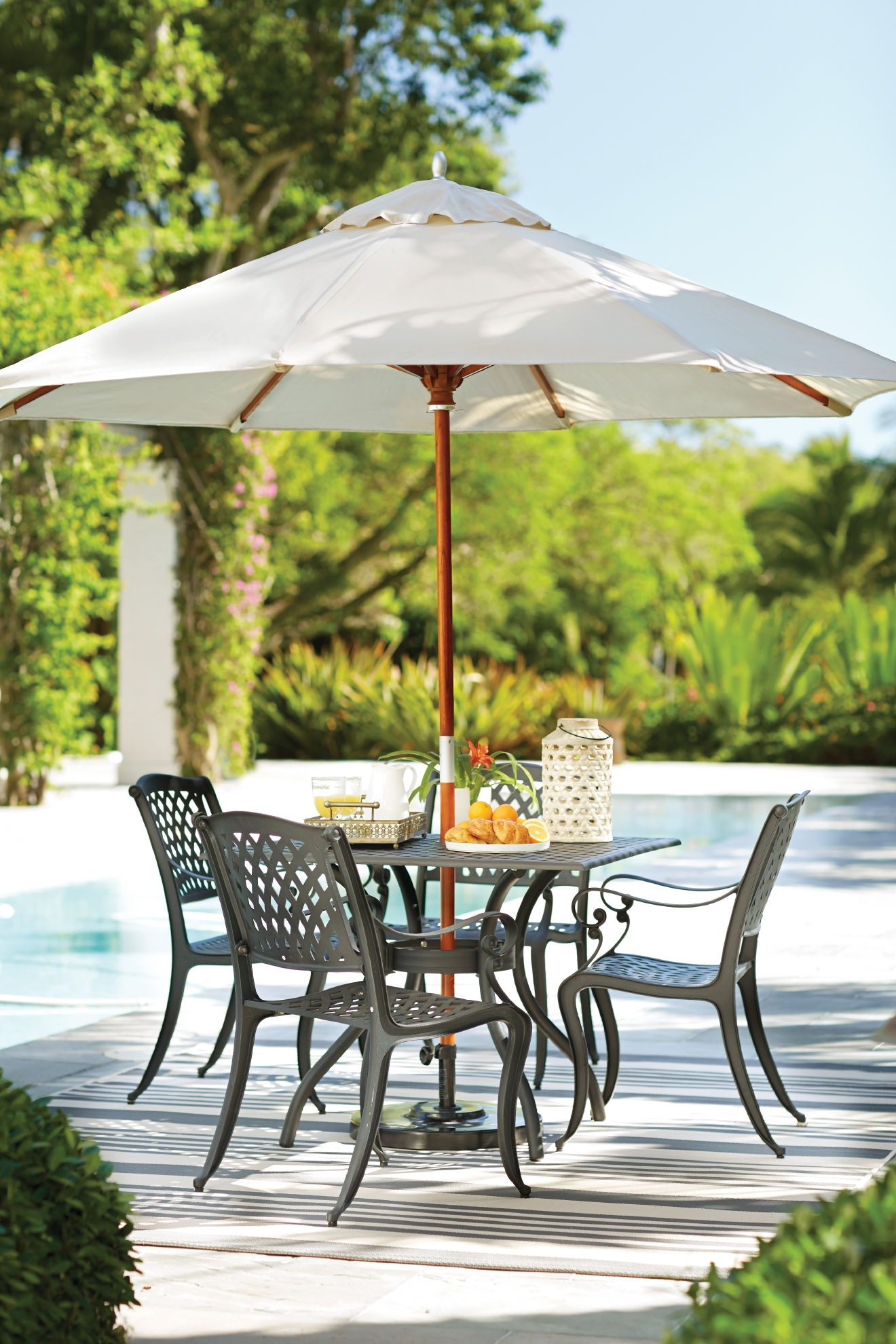 Summer is here, which means it's time to take the rain covers off the barbecue and dust off that table set! But not everyone can make an adorable Pinterest-worthy outdoor dining area, so we asked Porch, ATGStores.com and Wayfair (the true experts) to help us pick some pieces that take dining in your backyard to the next level. (Image: Wayfair)
